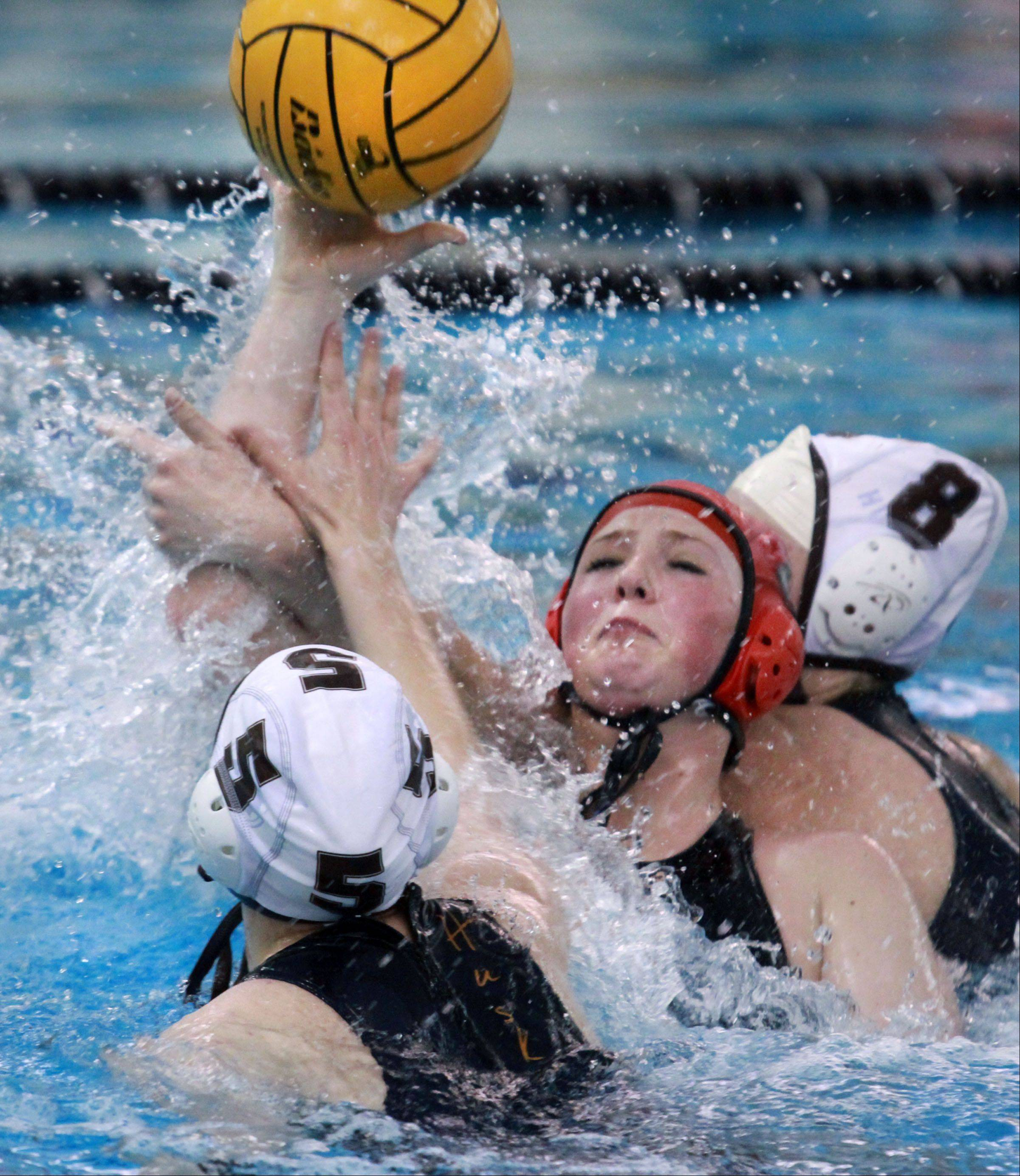 Barrington's Catherine Byron shoots between Hersey's Jill Hoffman, foreground, and Katie Lindholm during Wednesday's MSL water polo championship.
