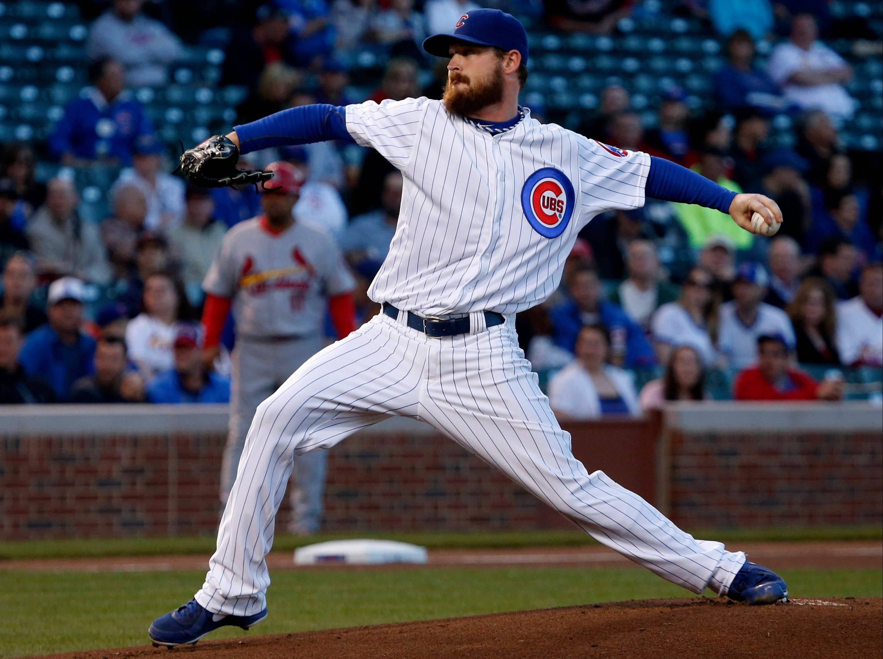 Cubs starting pitcher Travis Wood delivers during Tuesday's first inning at Wrigley Field.