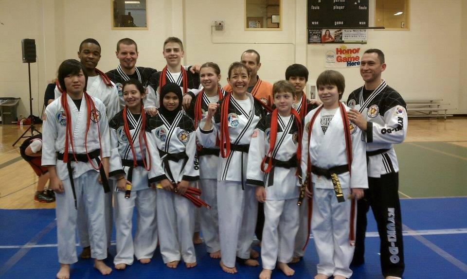 Elgin's Newest Black Belts! From left to right...Danny Albert, David Chenet, Greg Bodin, Sami Rose McCune, Sukaina Ali, Steve Tammes, Christy Tammes, Marivel Valenciano, Master Rick Steinmaier, Layne Congelosi, Haider Ali, Aiden Martin and Chief Instructor Seve Moreno