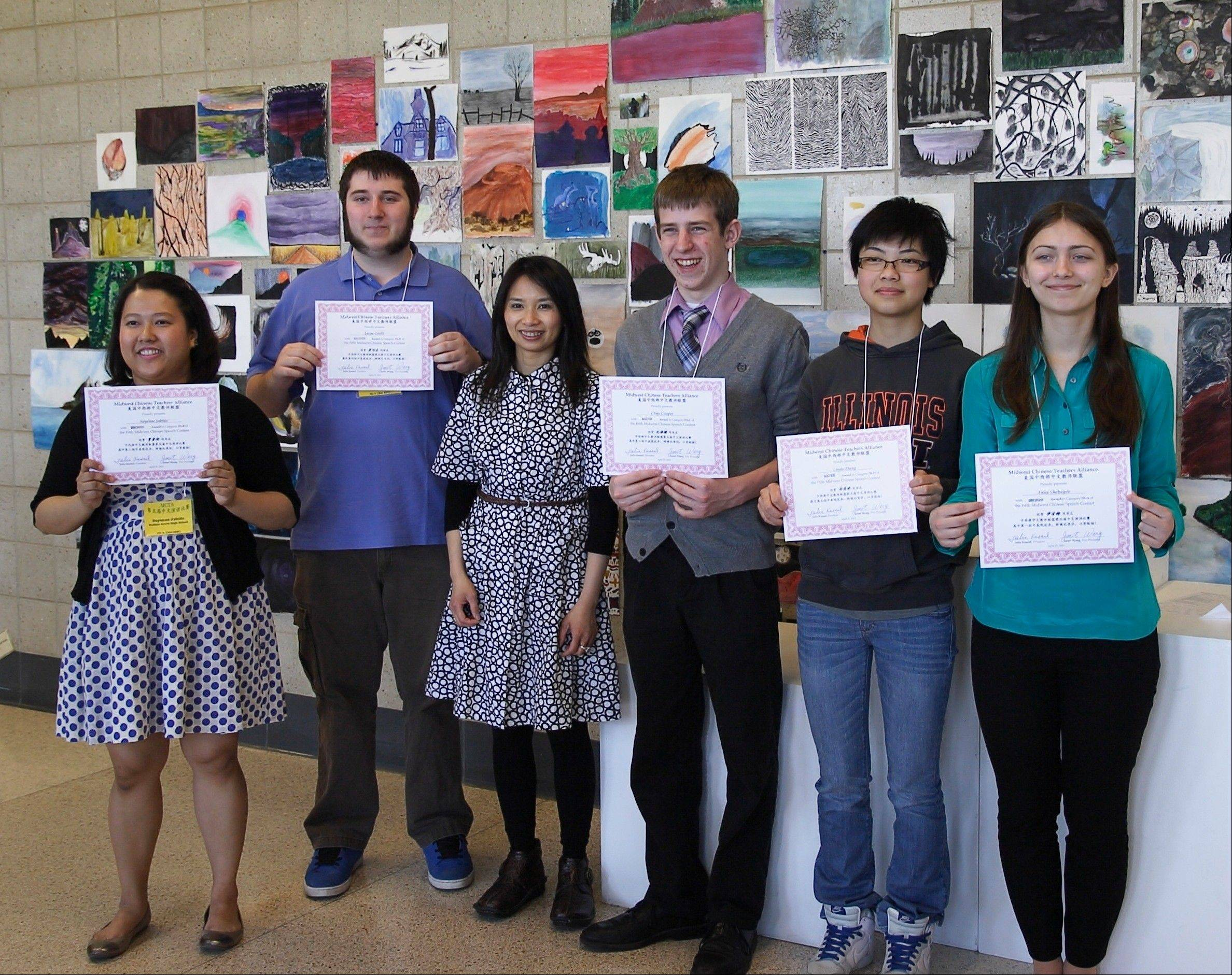 Buffalo Grove High School students display their awards at the fifth Midwest Chinese Speech Contest on April 27. Pictured, from left, are: Suyenne Jabido, Jason Giolli, teacher Caili Chiu, Christopher Cooper, Linda Zheng and Anna Shabayev.