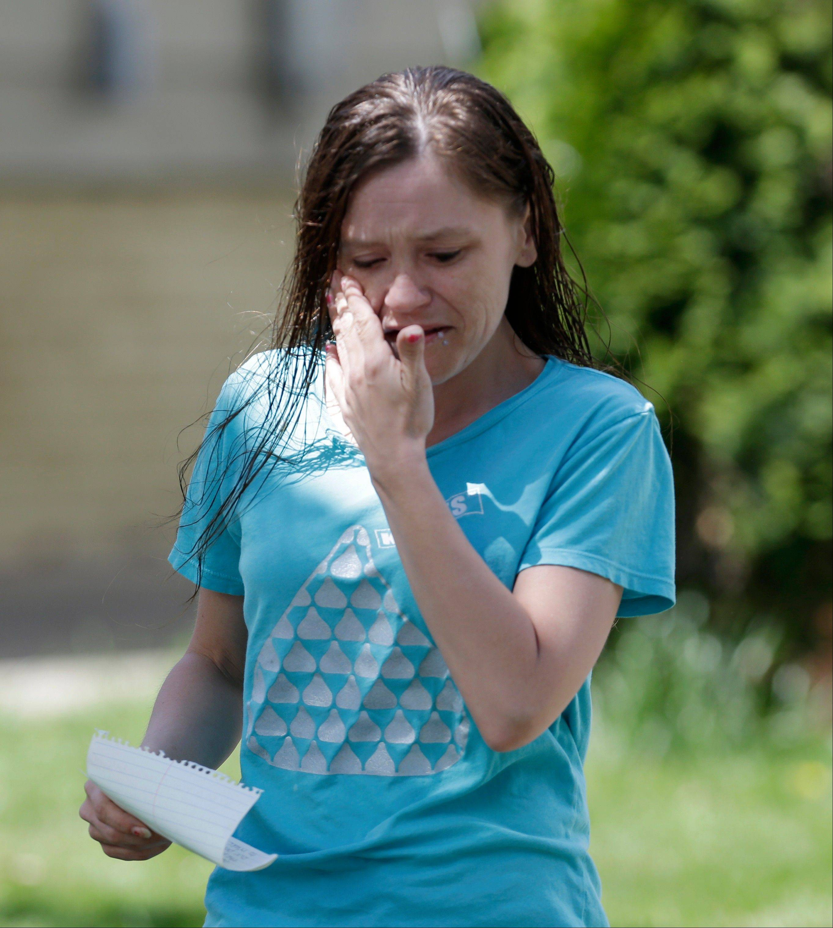 Beth Serrano, sister of Amanda Berry, wipes her eyes before speaking to the media after the arrival of Berry at Serrano's home Wednesday, May 8, 2013, in Cleveland. Berry, 27, Michelle Knight, 32, and DeJesus, about 23, had apparently been held captive in the house since their teens or early 20s, police said.