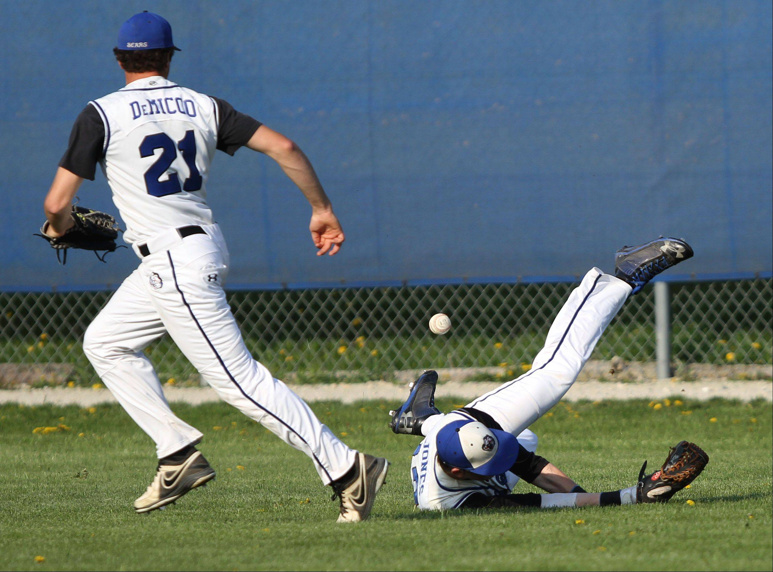 Lake Zurich�s Nick Jones, right, makes a diving attempt at a flyball as Dominic DeMicco tries to track down the ball against visiting Stevenson on Wednesday.