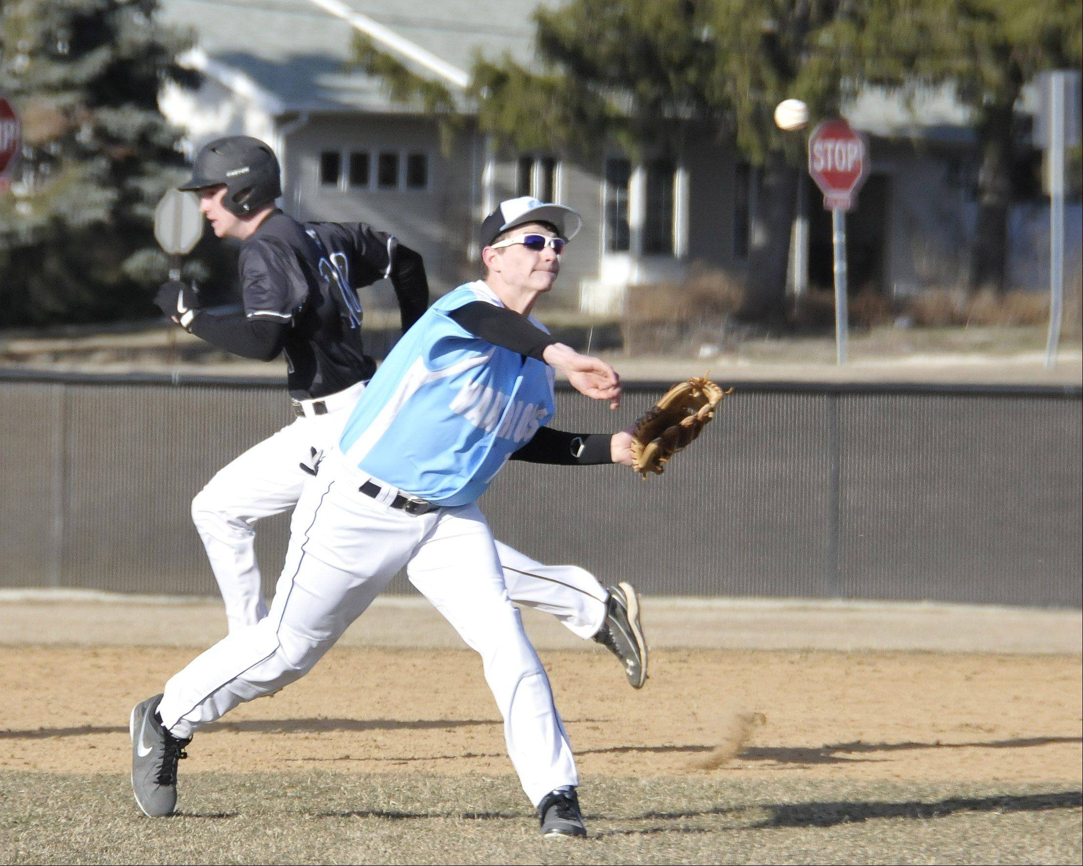 Willowbrook's shortstop AJ Nolen fires home in the 4th inning. Unfortunately for him and the Warriers, the throw went wide, allowing Hinsdale's fourth run to score. Hinsdale South played baseball Monday afternoon at Willowbrook High School in Villa Park.
