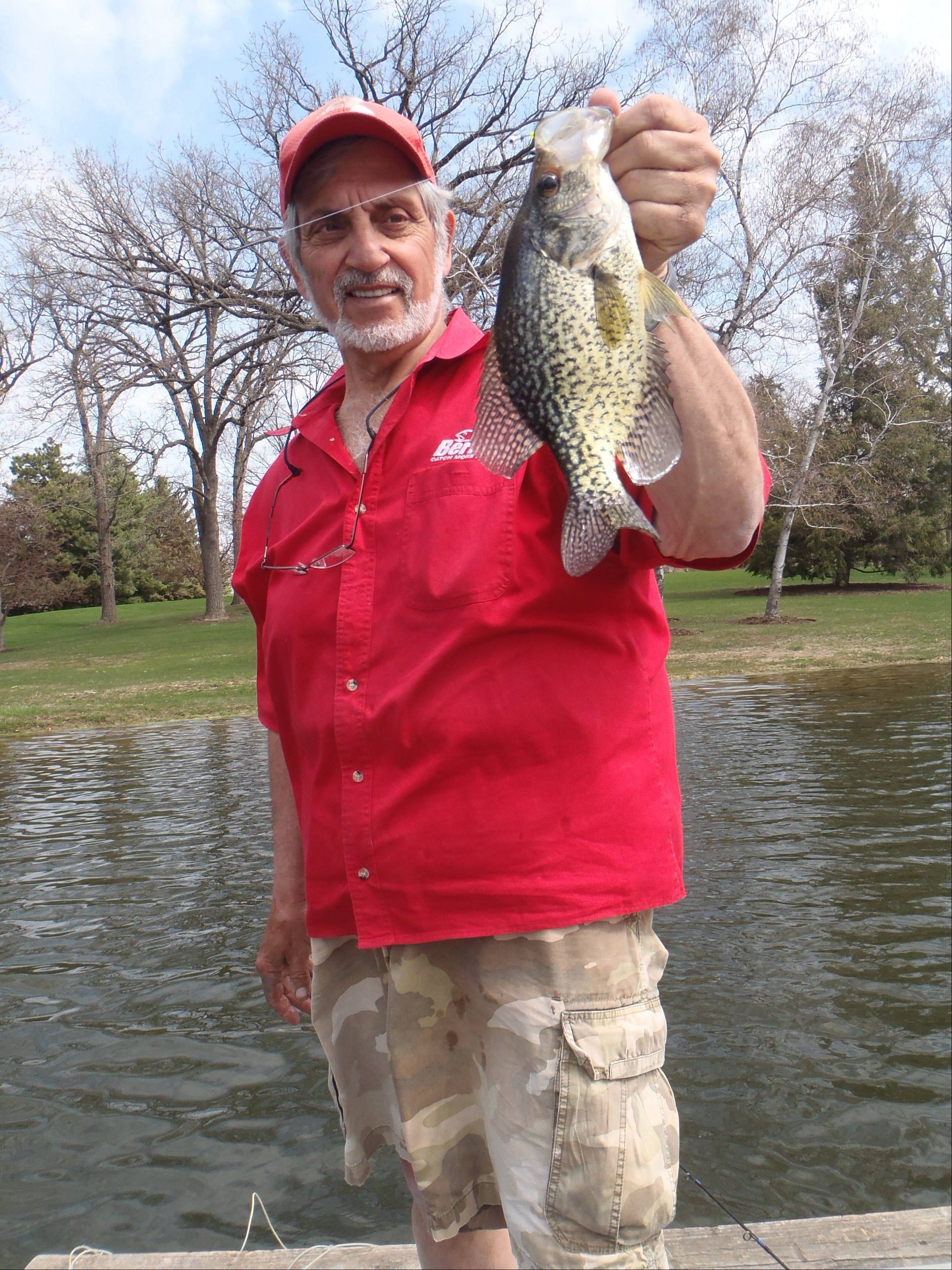 Spence Petros displays a hefty crappie, a bounty of spring fishing.