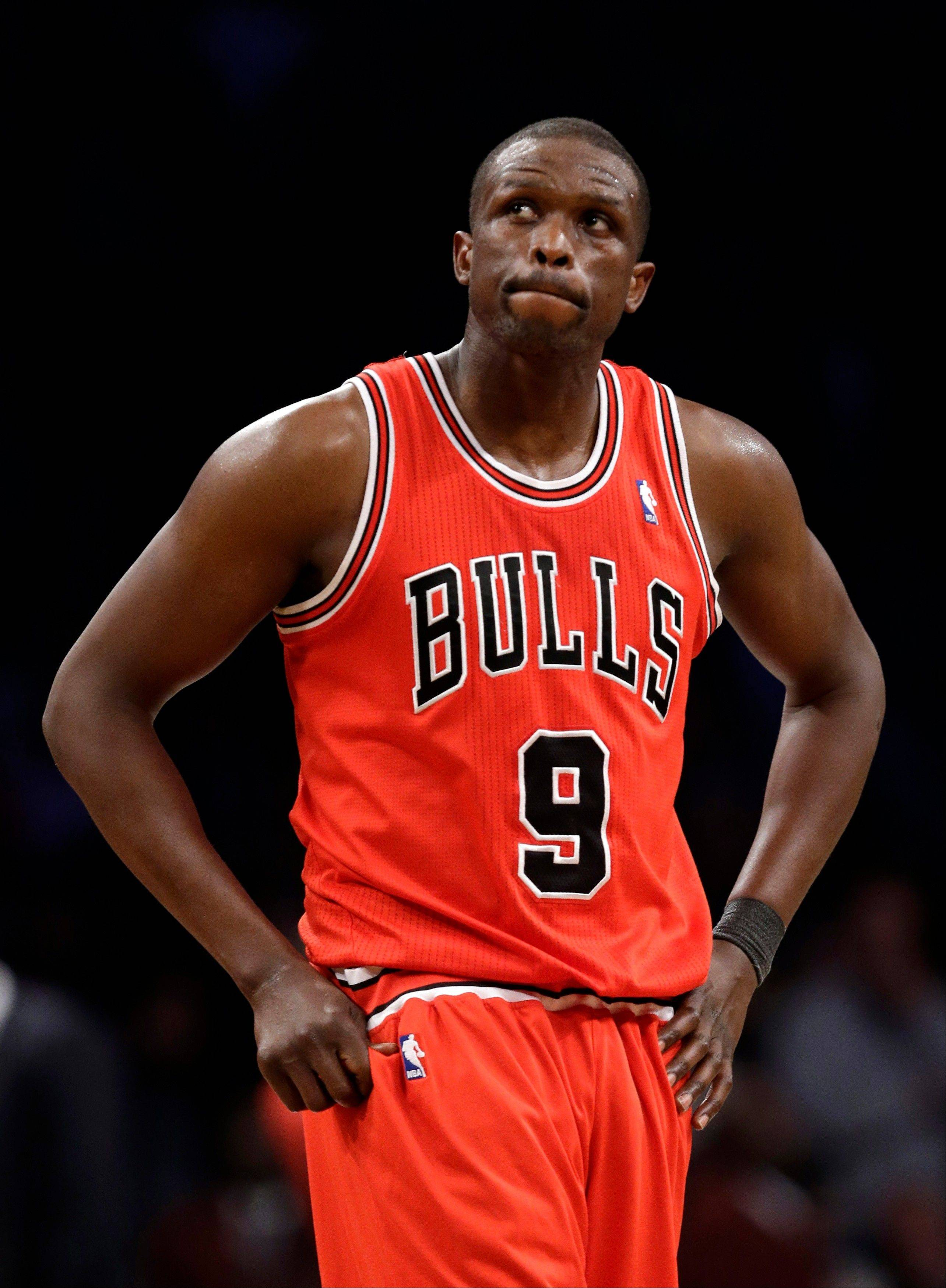 Bulls forward Luol Deng reacts in the second half of Game 5 against the Brooklyn Nets. Deng will not play in Game 2 against the Heat tonight.