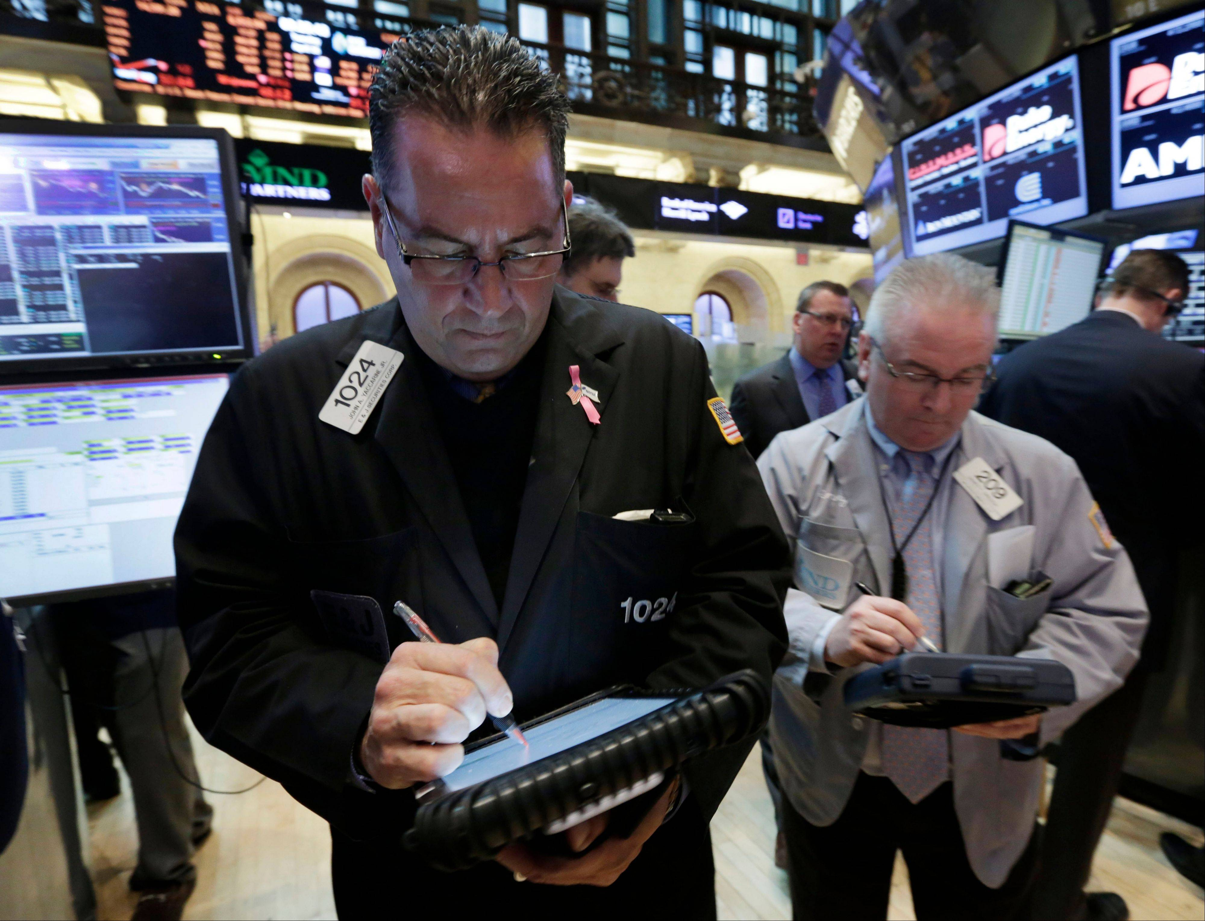 U.S. stocks rose, after the Dow Jones Industrial Average climbed above 15,000 for the first time yesterday, as earnings forecasts from Whole Foods Market Inc. and Electronic Arts Inc. beat analyst estimates.