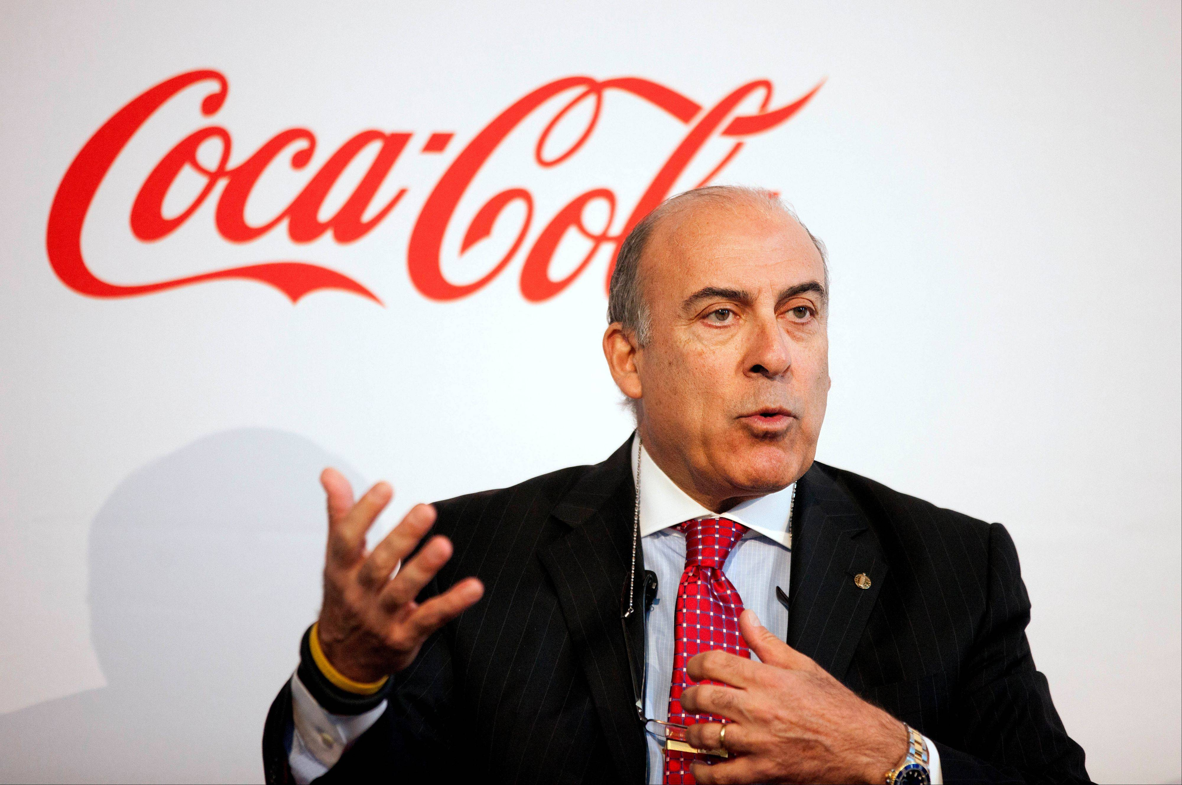 Coca-Cola CEO Muhtar Kent announces it will work to make lower-calorie drinks and clear nutrition information more widely available around the world Wednesday. The announcement from Coca-Cola comes as packaged food companies across the industry look for growth in developing markets, where middle-class populations are growing rapidly.