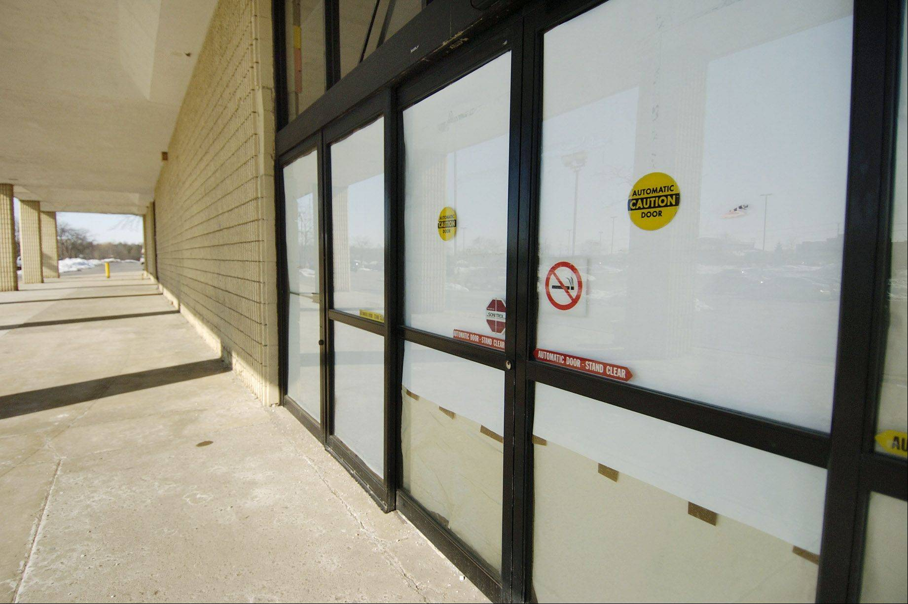 Paper covered the front windows of Hoffman Estates' Menards store after it closed in November 2008. The building has since been demolished. Village officials now are trying to recruit a new hardware store to town, as well as a would-be operator willing to invest in it.
