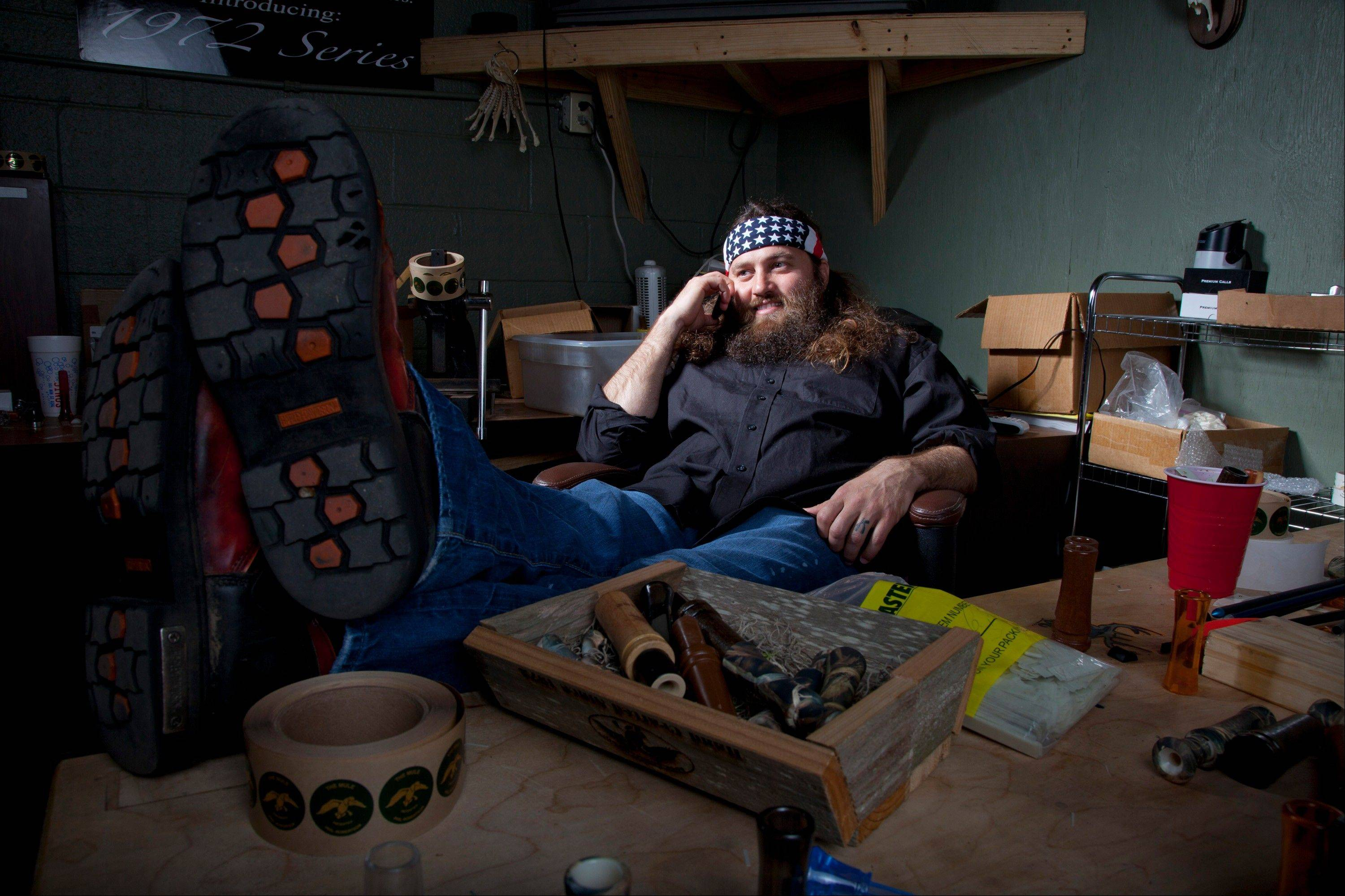 "Willie Robertson, star of A&E's ""Duck Dynasty,"" at his desk in his office at the Duck Commander warehouse in West Monroe, La. Turning small business owners into stars has become a winning formula for television producers, but some businesses featured in them are cashing in, too."