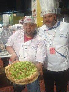 U.S. Pizza Team members Wilhelm Rodriguez, left, and Patrick Maggi, chef/founder of Pasquale's Pizzeria in Palatine.