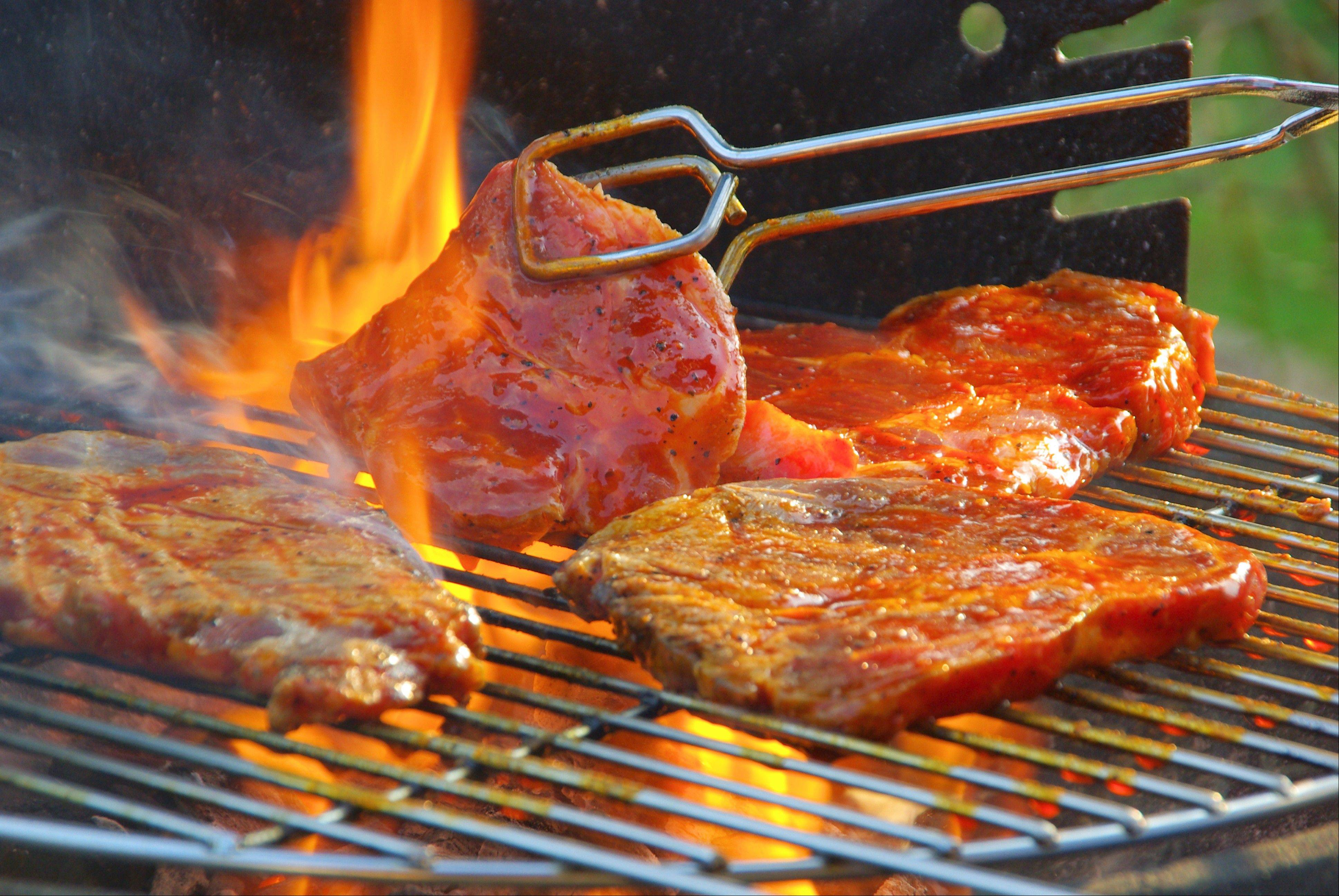 The best way to quell a flare-up is to put the lid back on the grill.