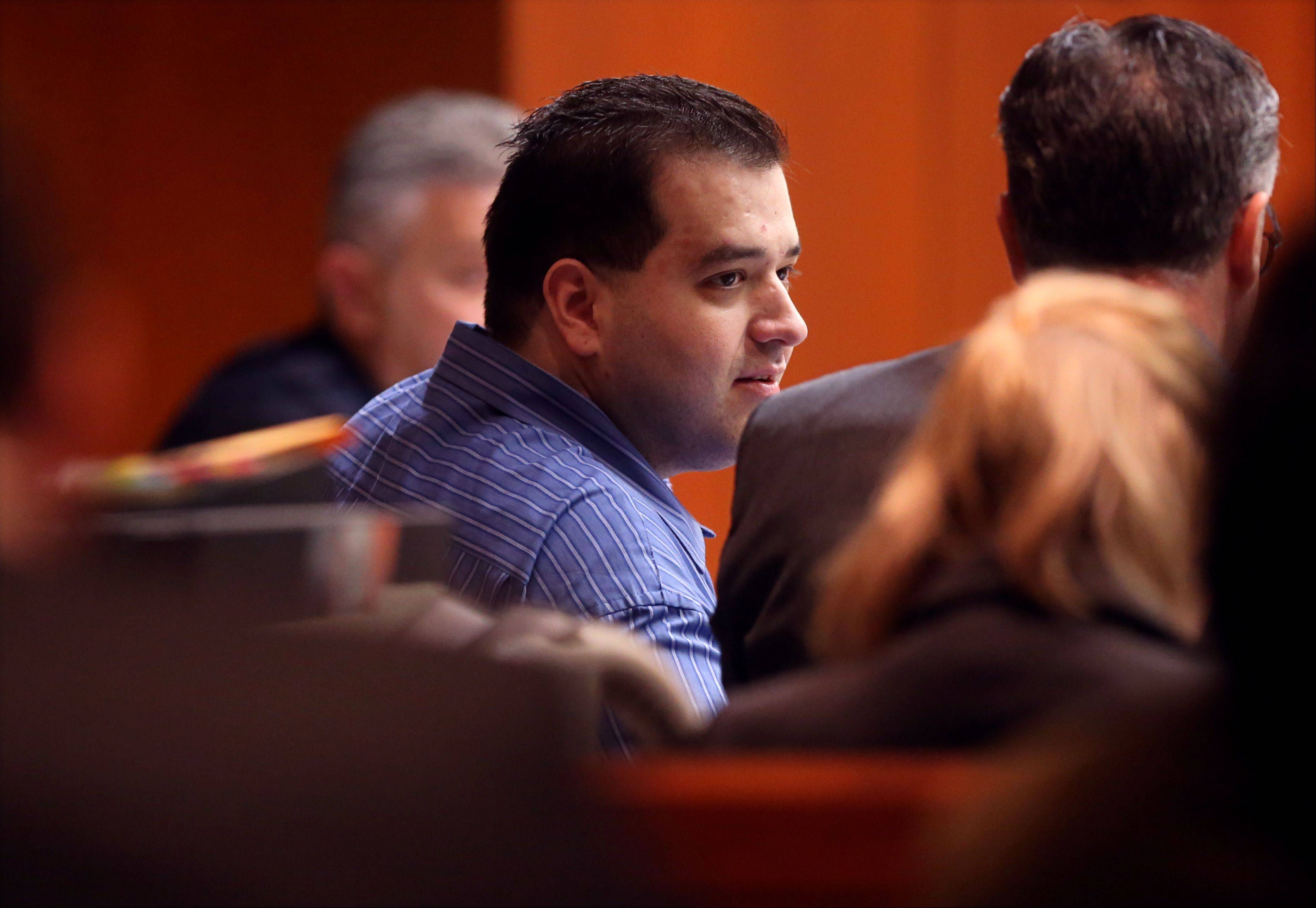 Johnny Borizov listens to the cross-examination of co-defendant Jacob Nodarse on April 26 at the DuPage County courthouse in Wheaton.