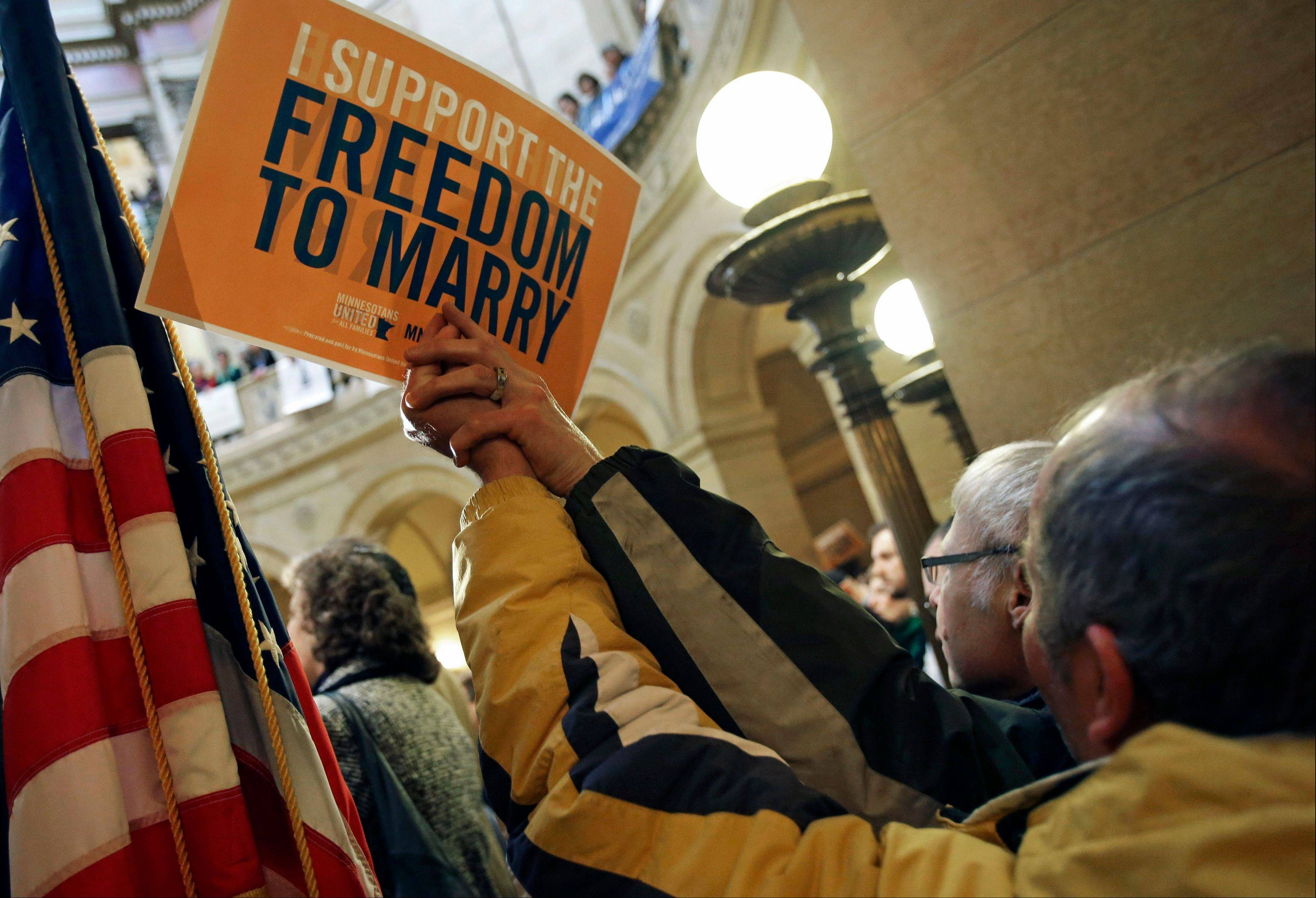 Supporters of gay marriage call for Minnesota lawmakers to legalize gay marriage at the State Capitol in St. Paul, Minn., Feb. 14.