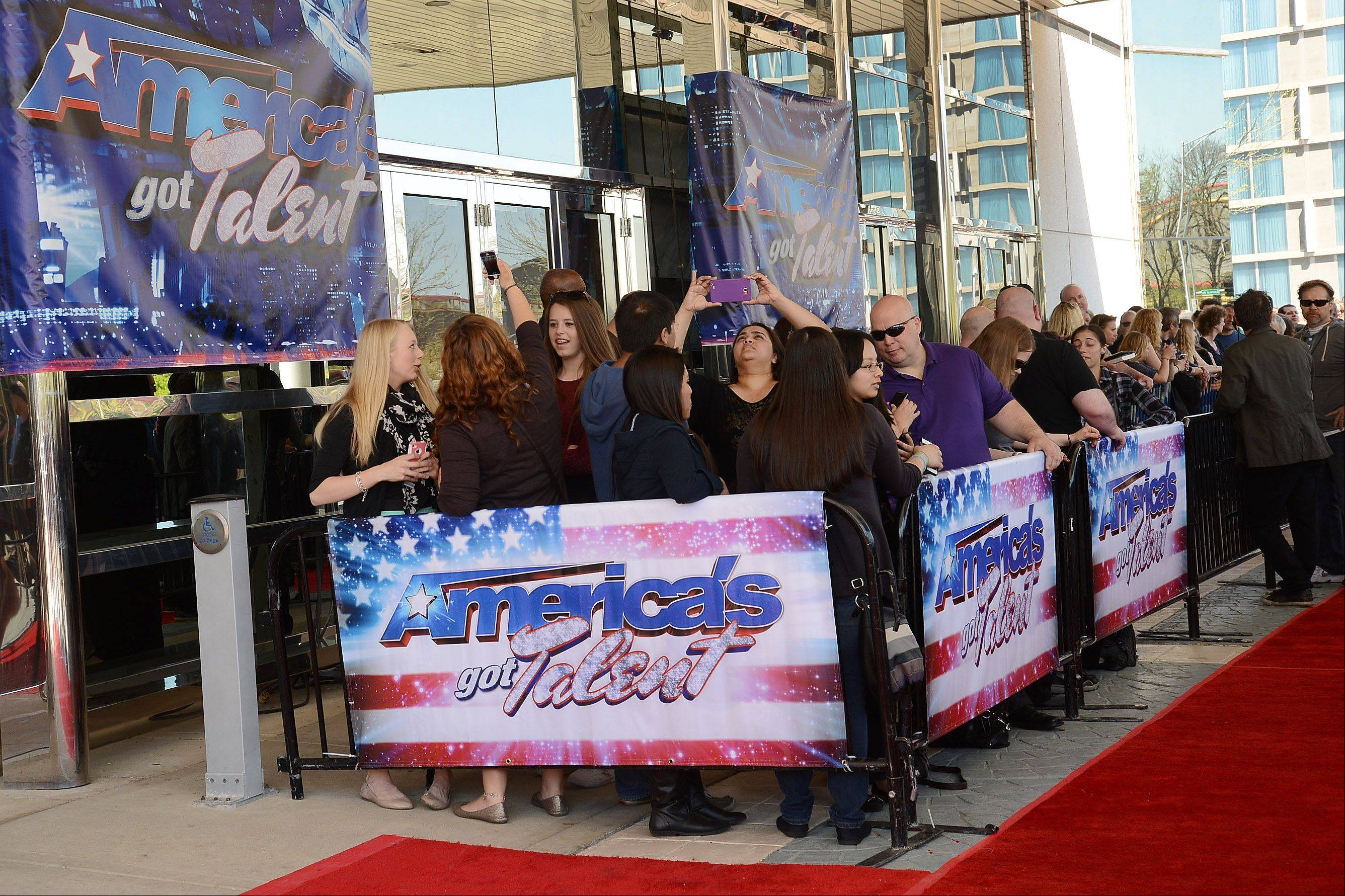 "A huge crowd waited along the red carpet route Wednesday for the judges to arrive at the ""America's Got Talent"" auditions at the Rosemont Theatre."
