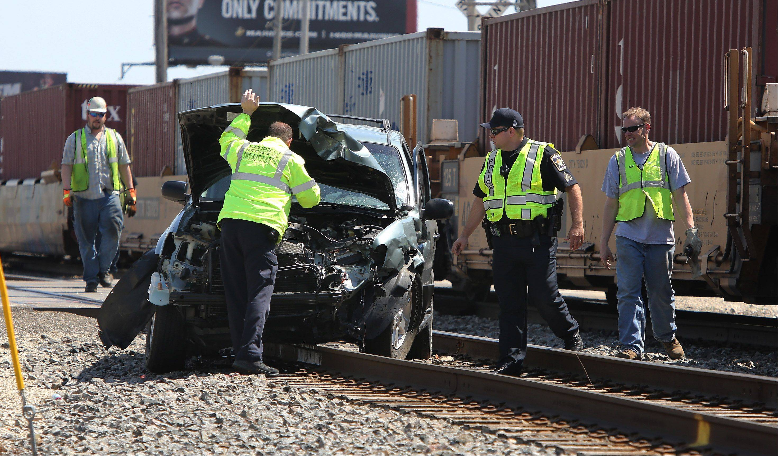 Emergency crews on the scene of a Wednesday afternoon crash involving a train and an SUV at routes 137 and 83 in Grayslake. The driver of the SUV was taken by ambulance to Advocate Condell Medical Center.