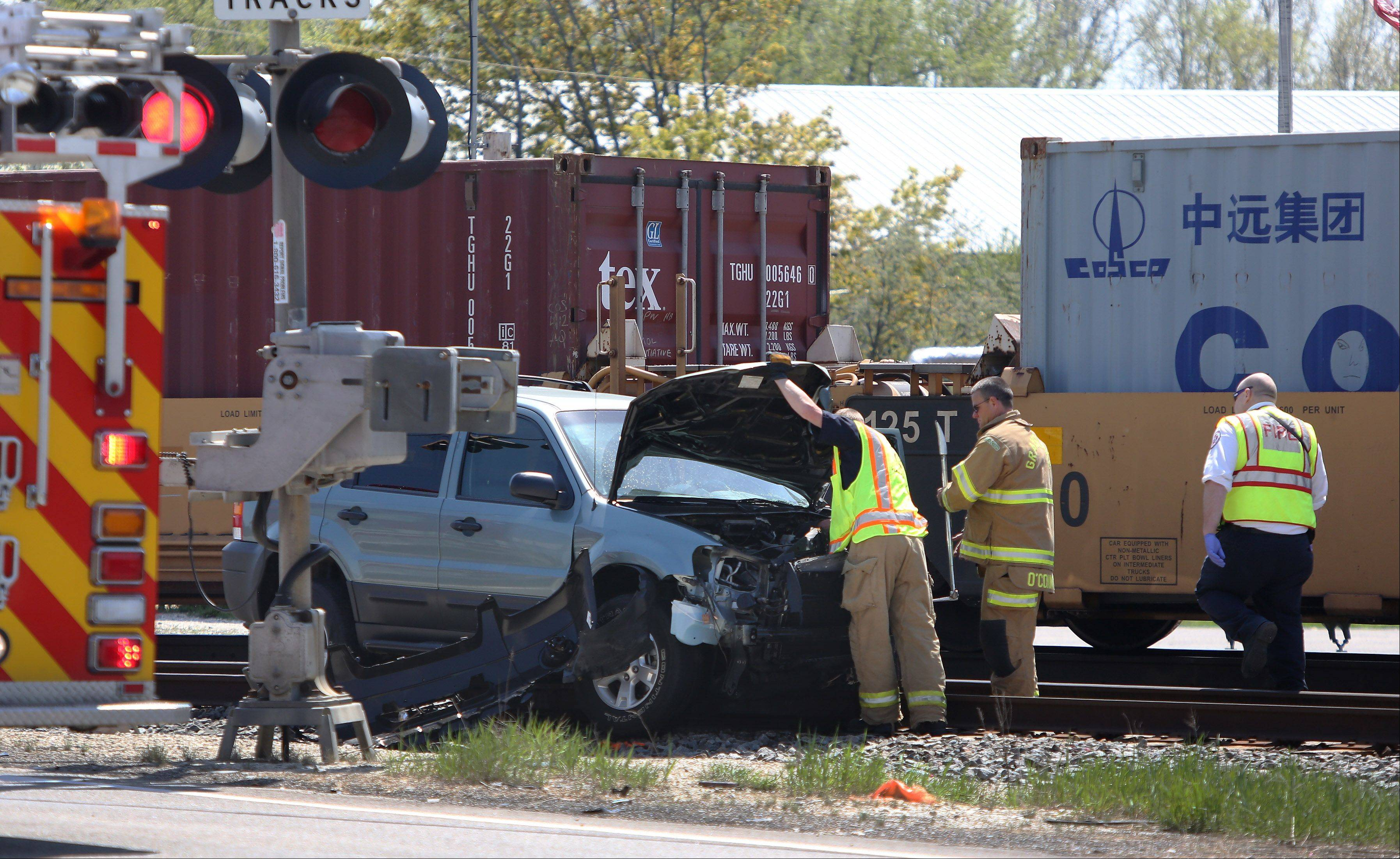 Emergency crews on the scene of a crash involving a train and an SUV at routes 137 and 83 in Grayslake on Wednesday. The driver of the vehicle was taken by ambulance to Advocate Condell Medical Center.