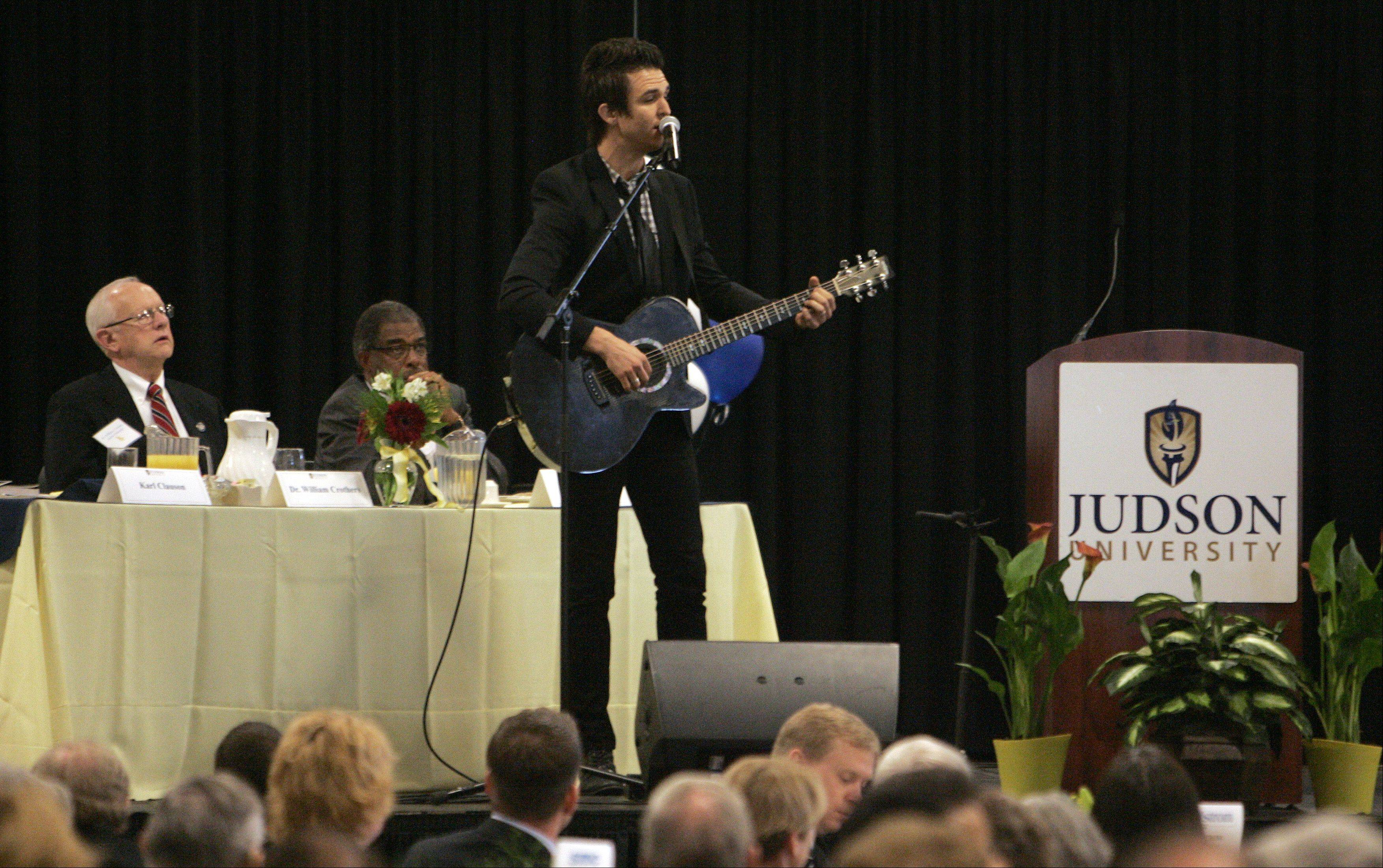 Judson graduate and Citizens Way musician Ben Calhoun offers prayer and a song Wednesday during the university's annual prayer breakfast in Elgin.