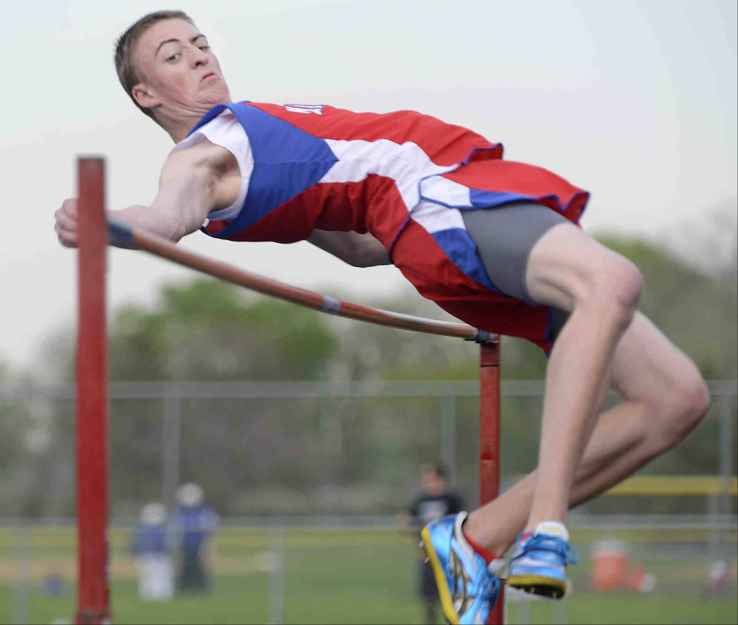Marmion Academy's Tyler Maryanski muscles his way over the high jump bar set at 6 feet five inches for first place Wednesday at the Suburban Christian Conference boys track meet at Aurora Central Catholic.