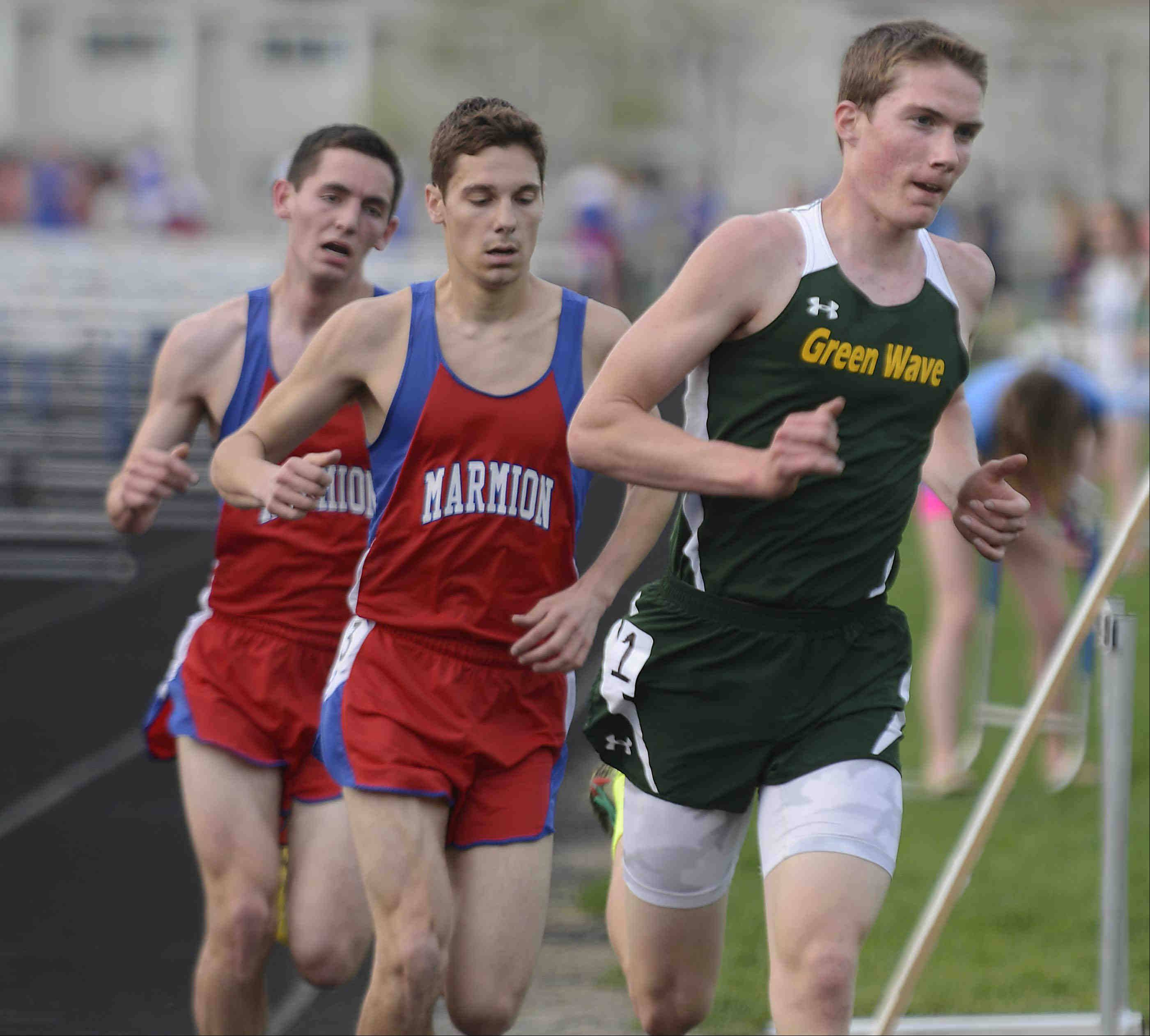 St. Edward's John Danner leads Marmion Academy's Eric Anderson and Nick Delaney in the 3,200-meter fun Wednesday at the Suburban Christian Conference boys track meet at Aurora Central Catholic. Danner won the event.