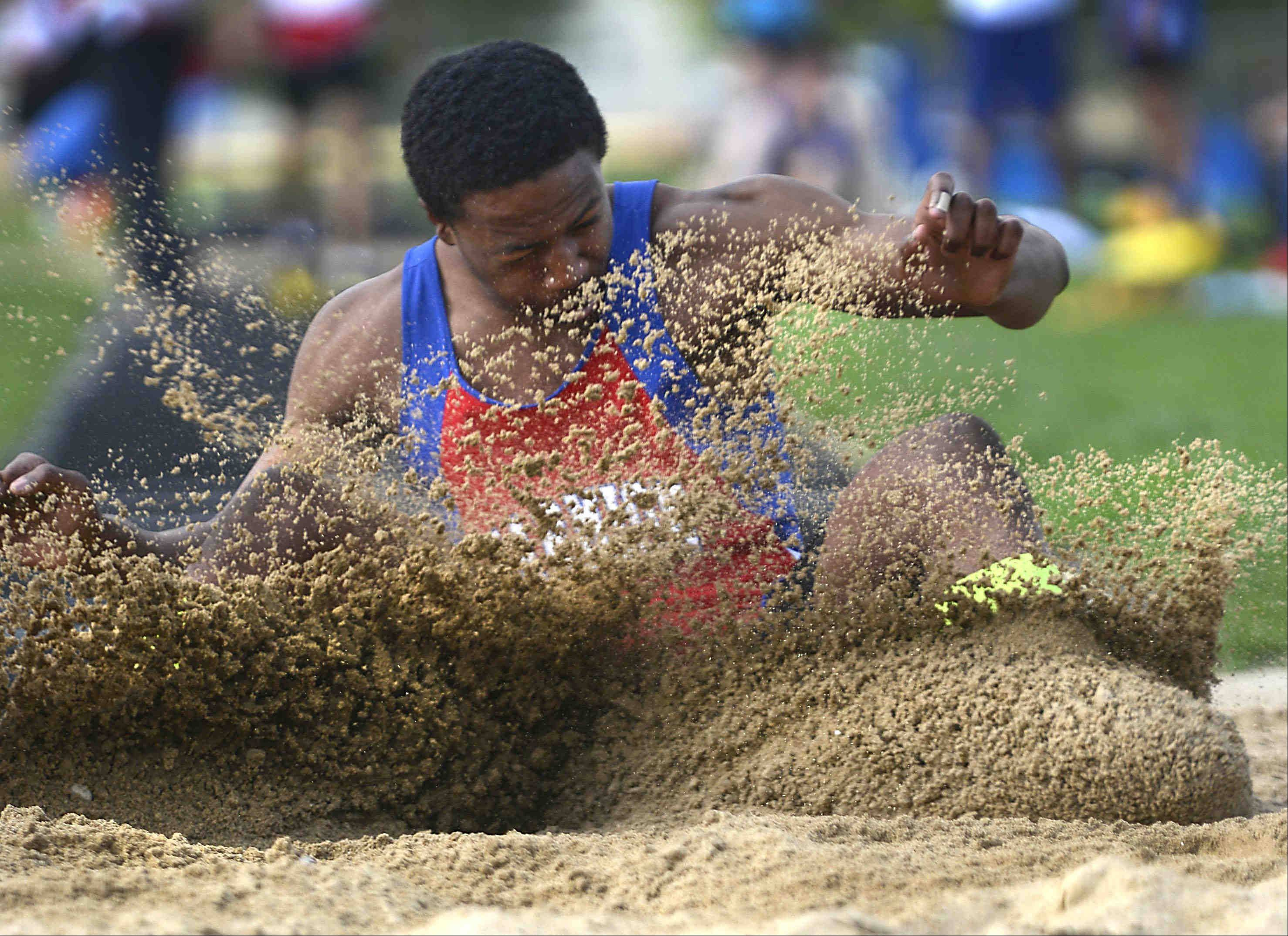 Marmion Academy's Isaiah Brown wins the long jump Wednesday at the Suburban Christian Conference boys track meet at Aurora Central Catholic.