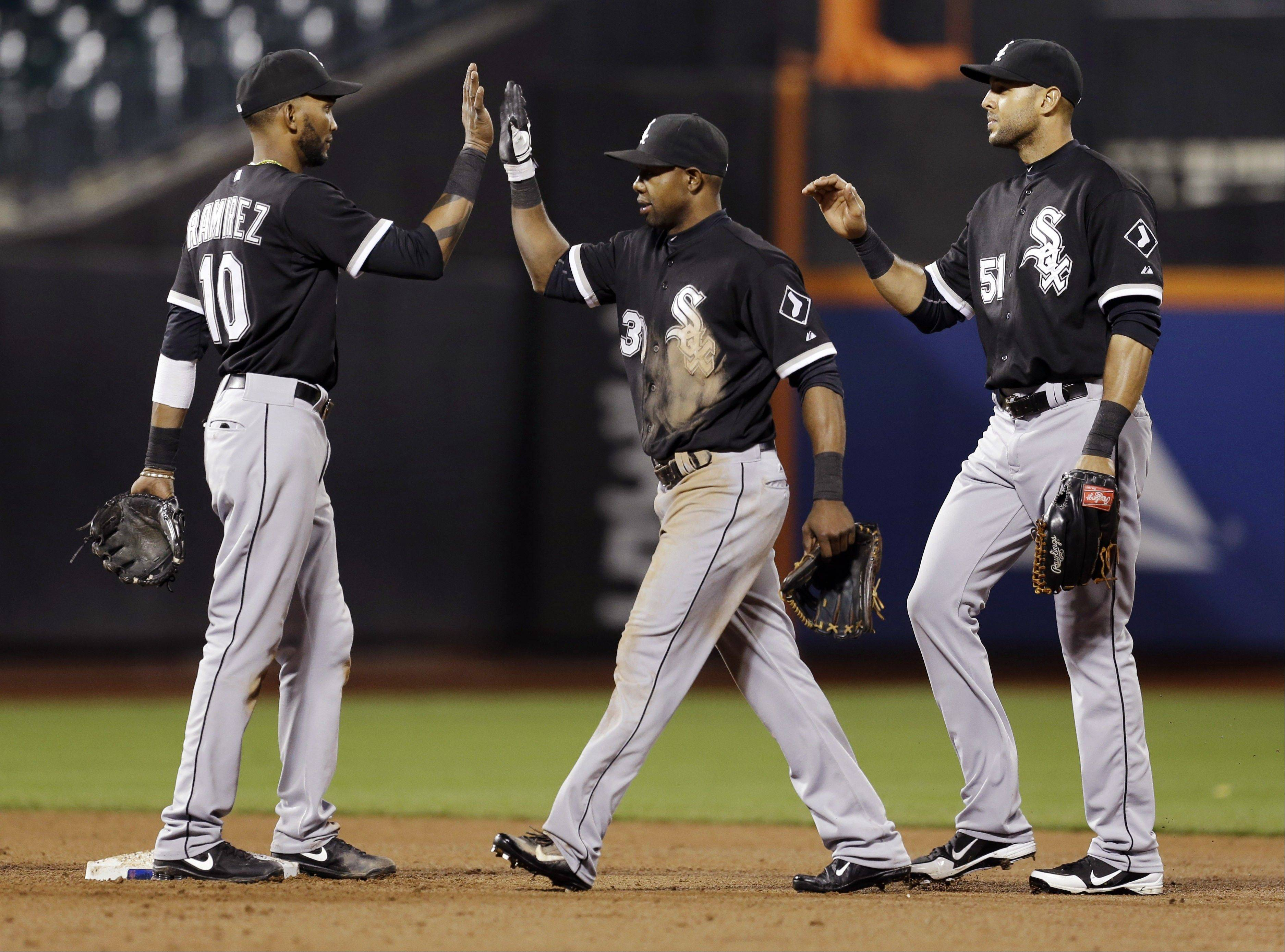 Alexei Ramirez, left, Alejandro De Aza, center, and Alex Rios celebrate after the White Sox beat the Mets on Wednesday in New York. The White Sox won 6-3.