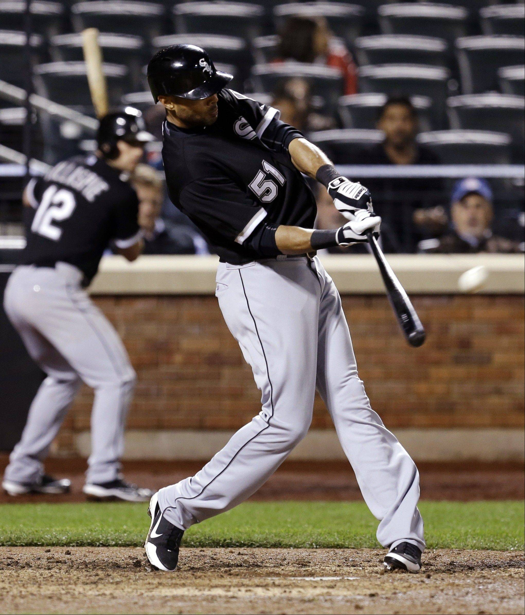 Alex Rios hits a solo home run during the ninth inning of a baseball game against the New York Mets at Citi Field, Wednesday, May 8, 2013, in New York. The White Sox won 6-3.
