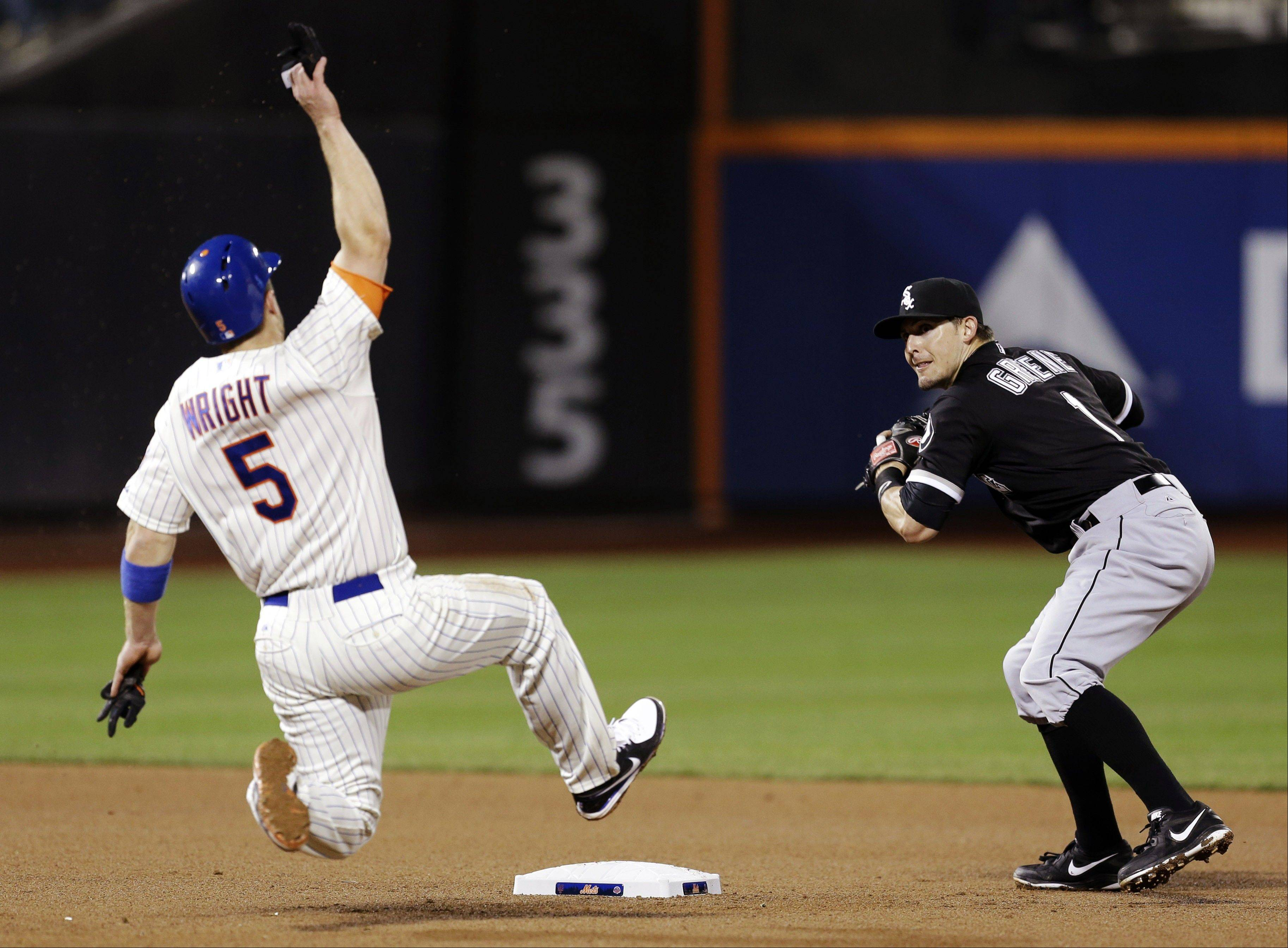 White Sox second baseman Tyler Greene, right, turns a double play as New York Mets' David Wright slides into second base during the fourth inning of a baseball game at Citi Field, Wednesday, May 8, 2013, in New York.