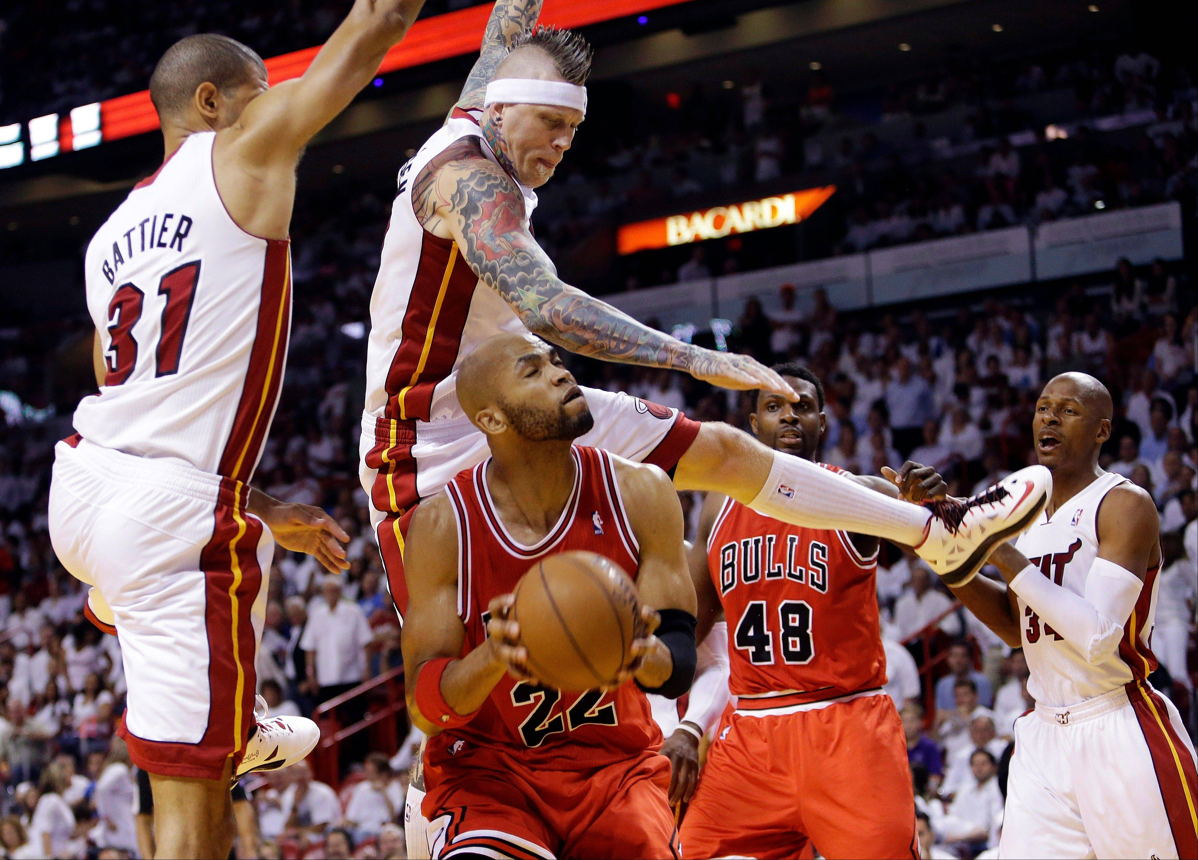 Taj Gibson (22) attempts to shoot as Miami Heat's Shane Battier (31) and Chris Andersen, center, defend in the second half of Game 2 of their NBA basketball playoff series in the Eastern Conference semifinals, Wednesday, May 8, 2013, in Miami. The Heat won 115-78.