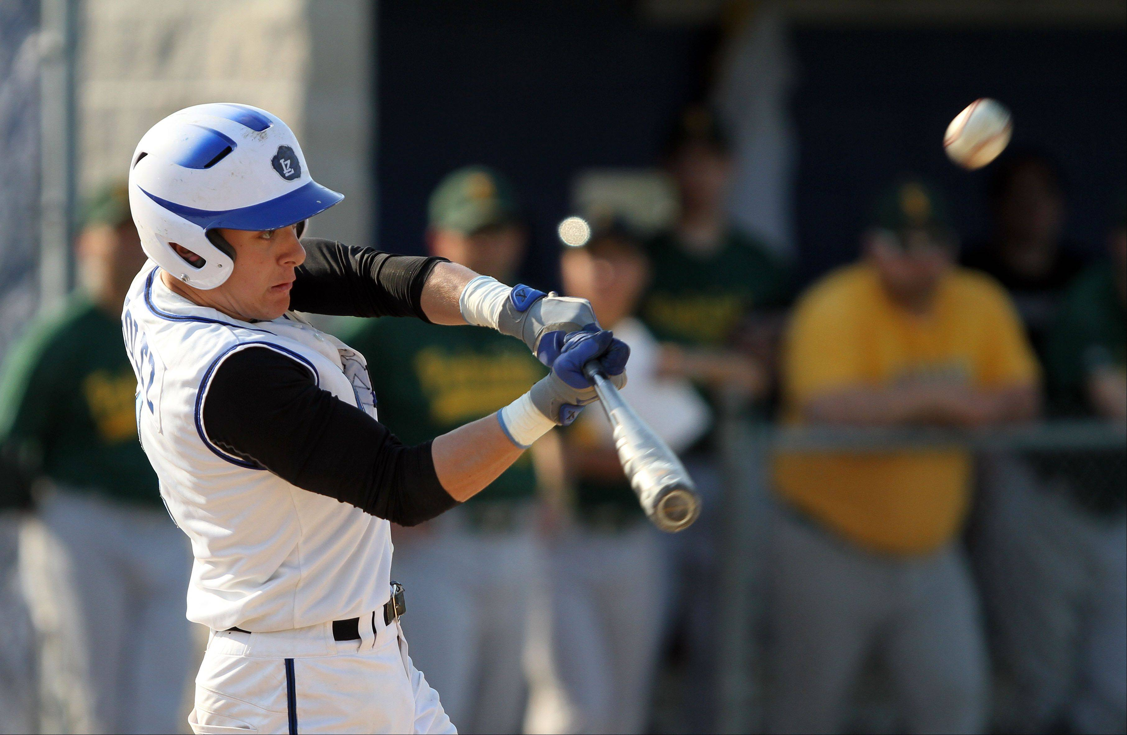Lake Zurich's Joey Holtz connects for a triple against visiting Stevenson on Wednesday.