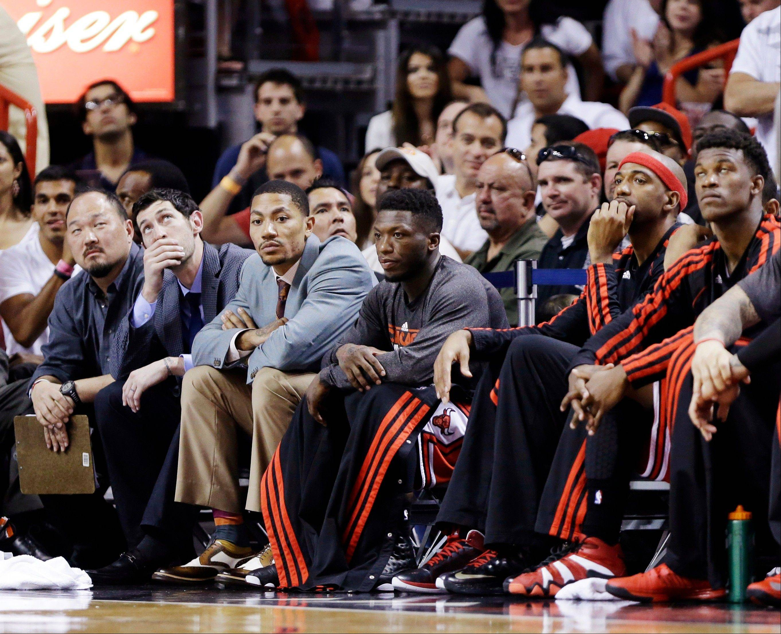 From left, Chicago Bulls' Kirk Hinrich, Derrick Rose, Nate Robinson, Richard Hamilton and Jimmy Butler watch from the bench during the final seconds of Game 2 of the NBA basketball playoff series in the Eastern Conference semifinals against the Miami Heat Wednesday night in Miami. The Heat won 115-78.