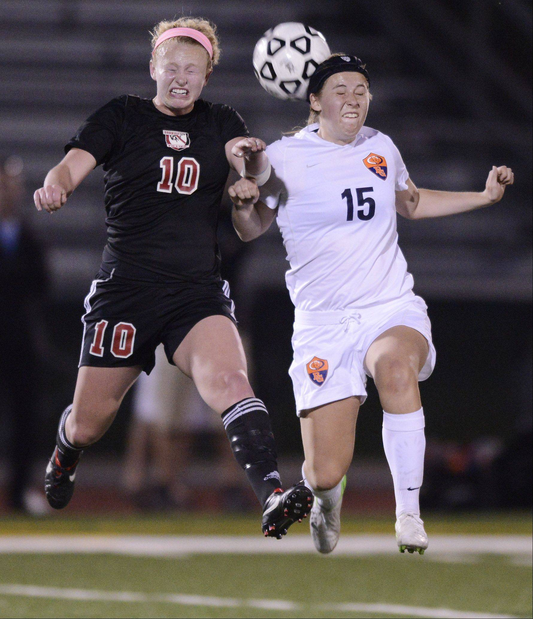 Barrington's Molly Pfeiffer, left, and Buffalo Grove's Kelly VandeMerkt leap for a header during Wednesday's Mid-Suburban League championship game at Buffalo Grove.
