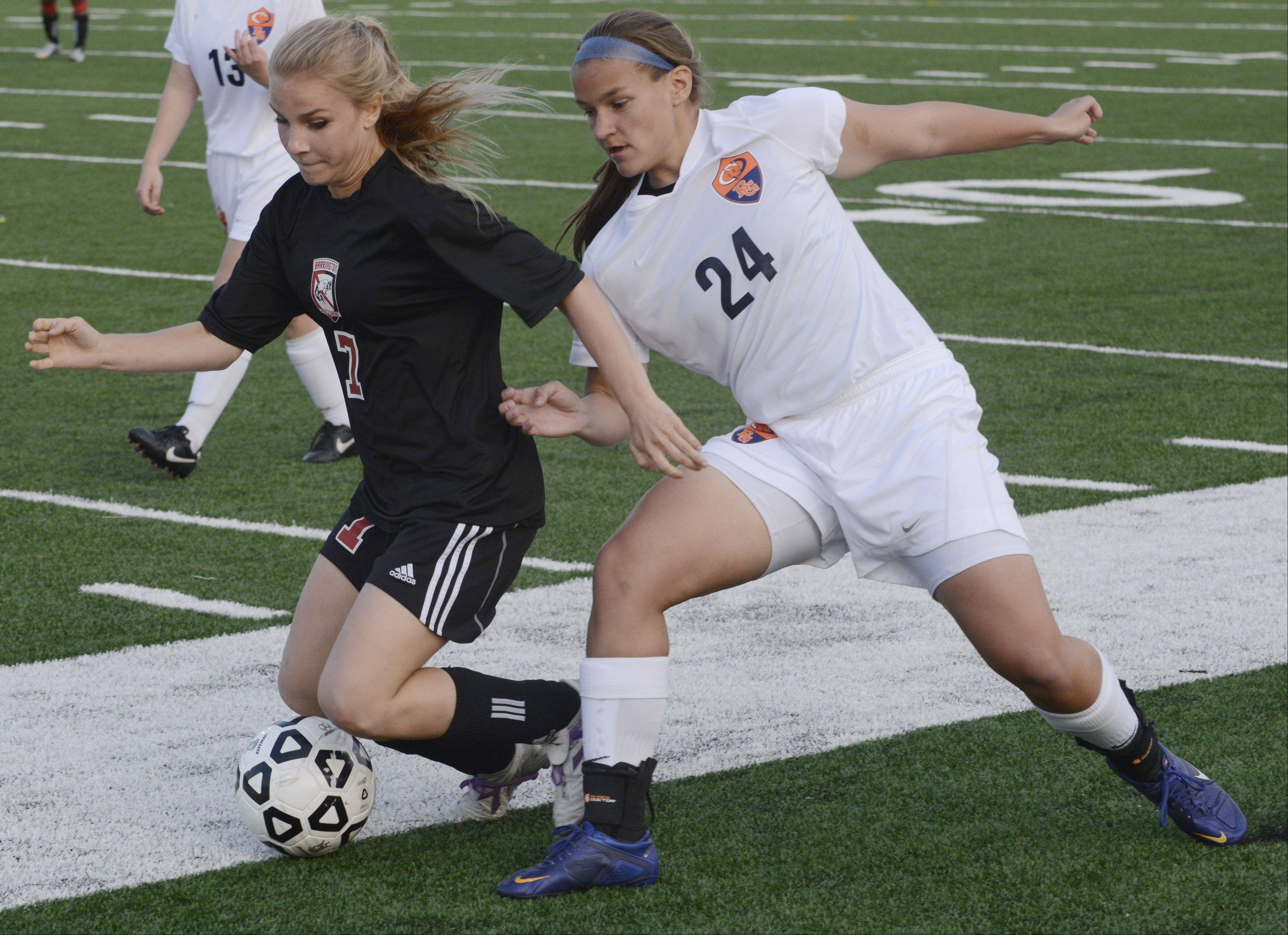 Barrington's Alex Avers, left, and Buffalo Grove's Sara Busse make contact while trying to get to the ball during Wednesday's Mid-Suburban League championship game at Buffalo Grove.