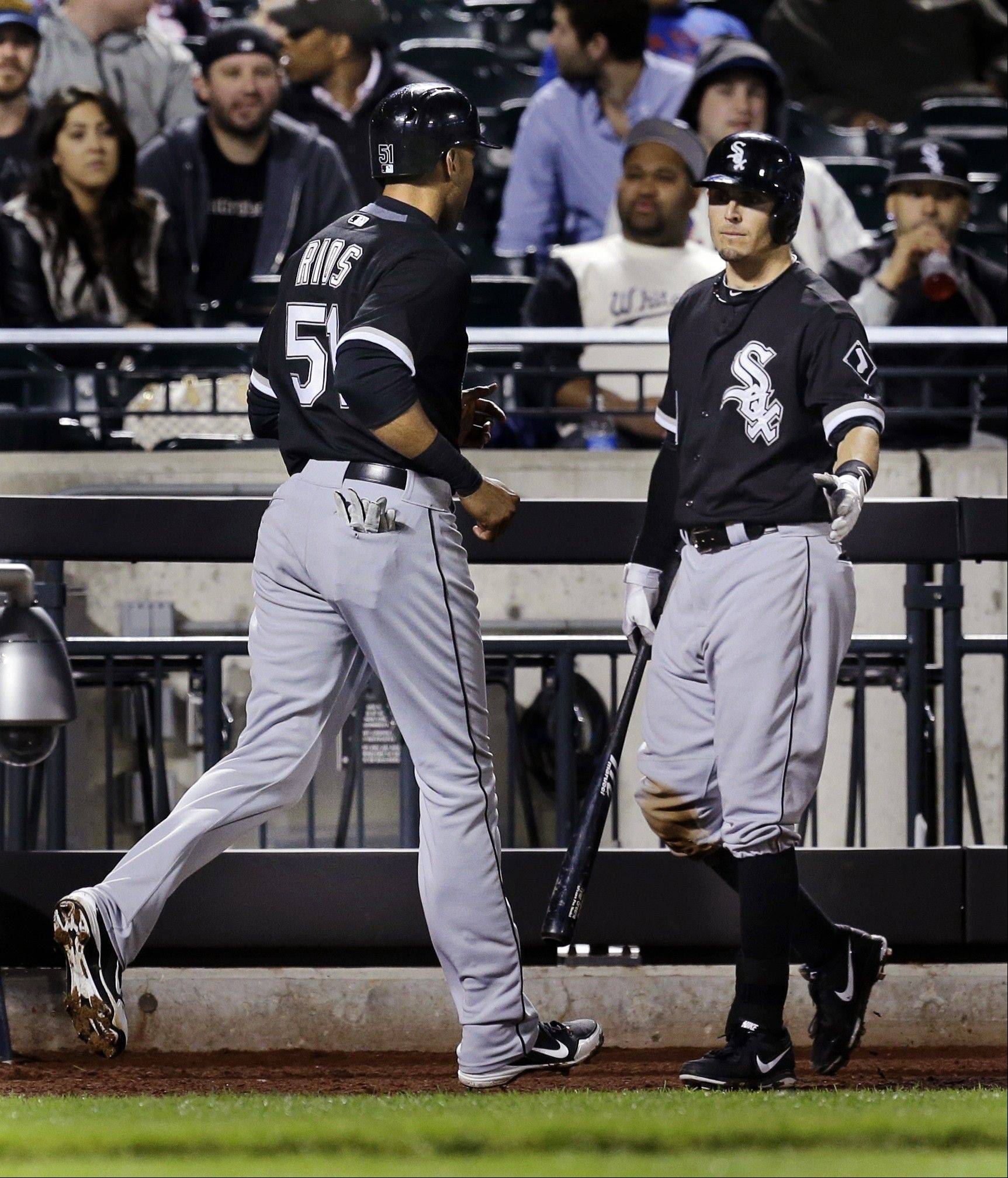 The White Sox's Tyler Greene, right, greets Alex Rios after Rios scored on a single by Paul Konerko Wednesday night against the Mets in New York. The White Sox won 6-3.