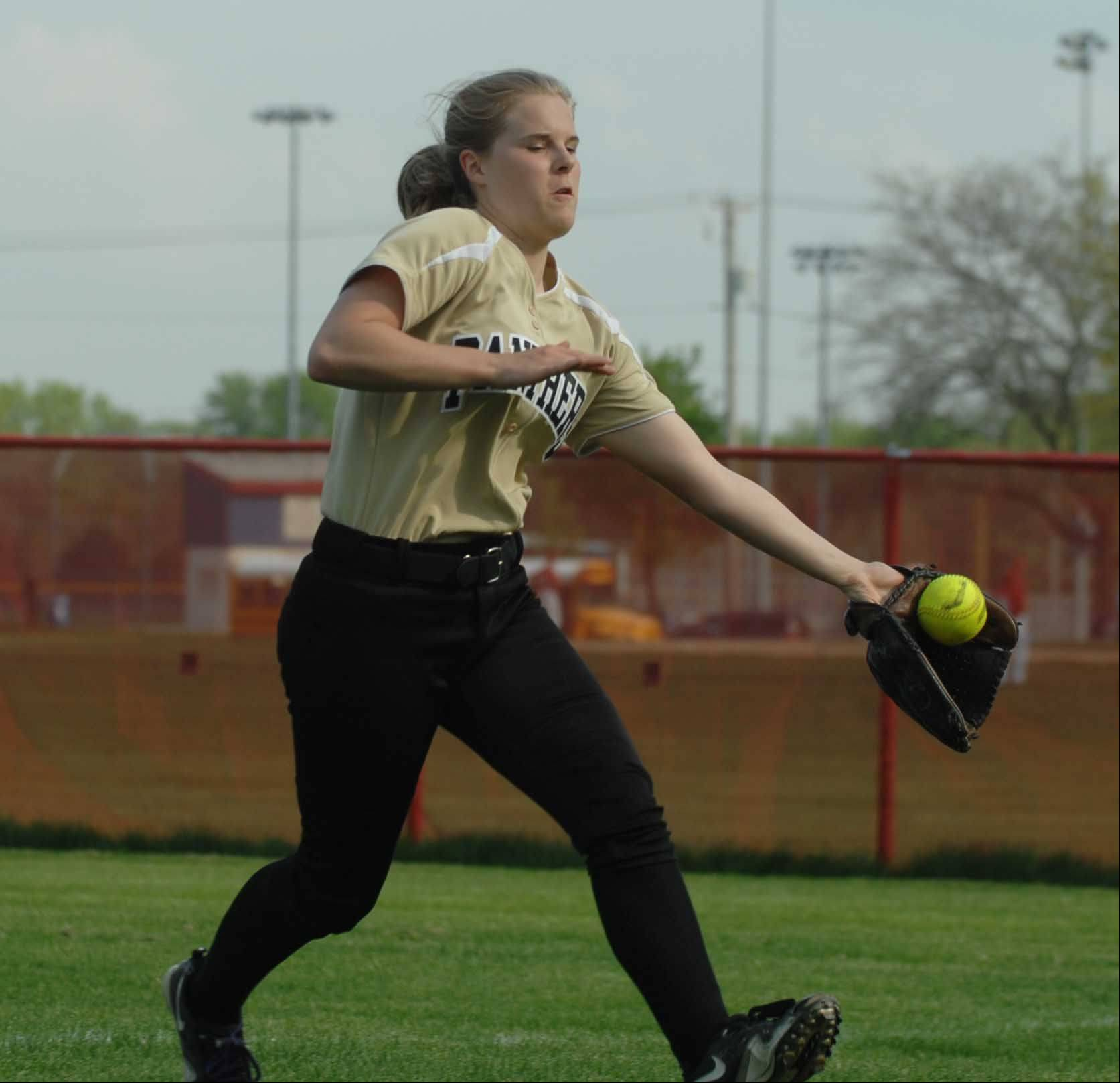 Amanda Manton of Glenbard North catches a hit to right field during the Glenbard North at Naperville Central softball game Wednesday.