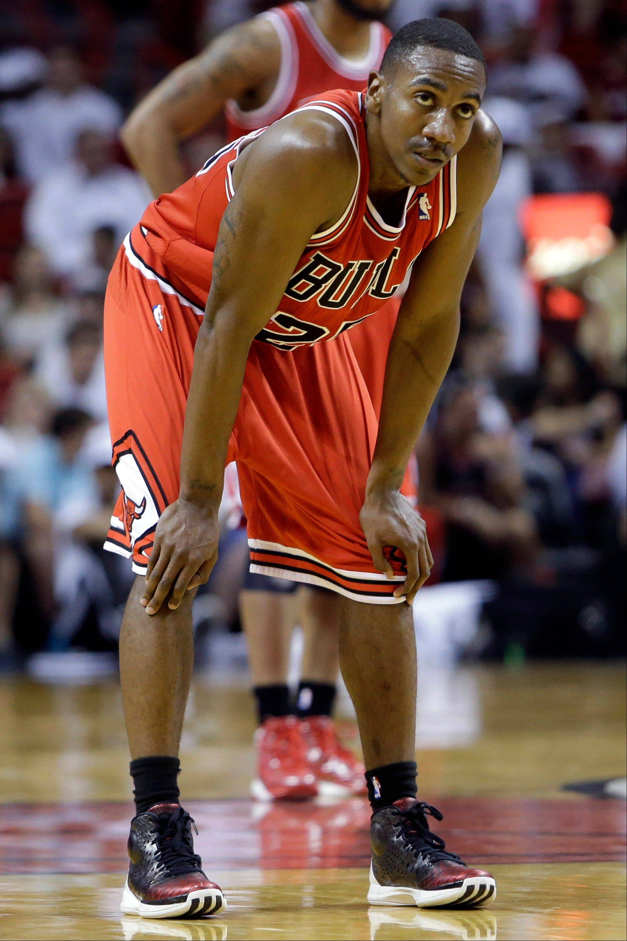 Chicago Bulls' Marquis Teague watches from the court in the second half of Game 2 of their NBA basketball playoff series in the Eastern Conference semifinals against the Miami Heat, Wednesday, May 8, 2013, in Miami. The Heat won 115-78.