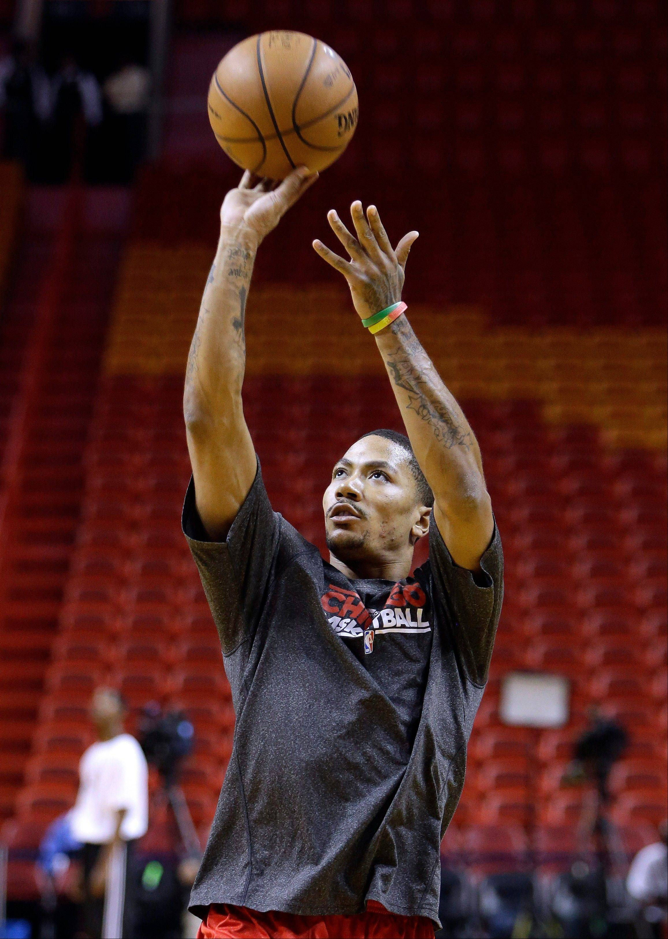 Chicago Bulls' Derrick Rose shoots before Game 2 of the NBA basketball Eastern Conference semifinals between the Bulls and the Miami Heat, Wednesday, May 8, 2013, in Miami. Rose has not played since hurting his knee in April 2012.
