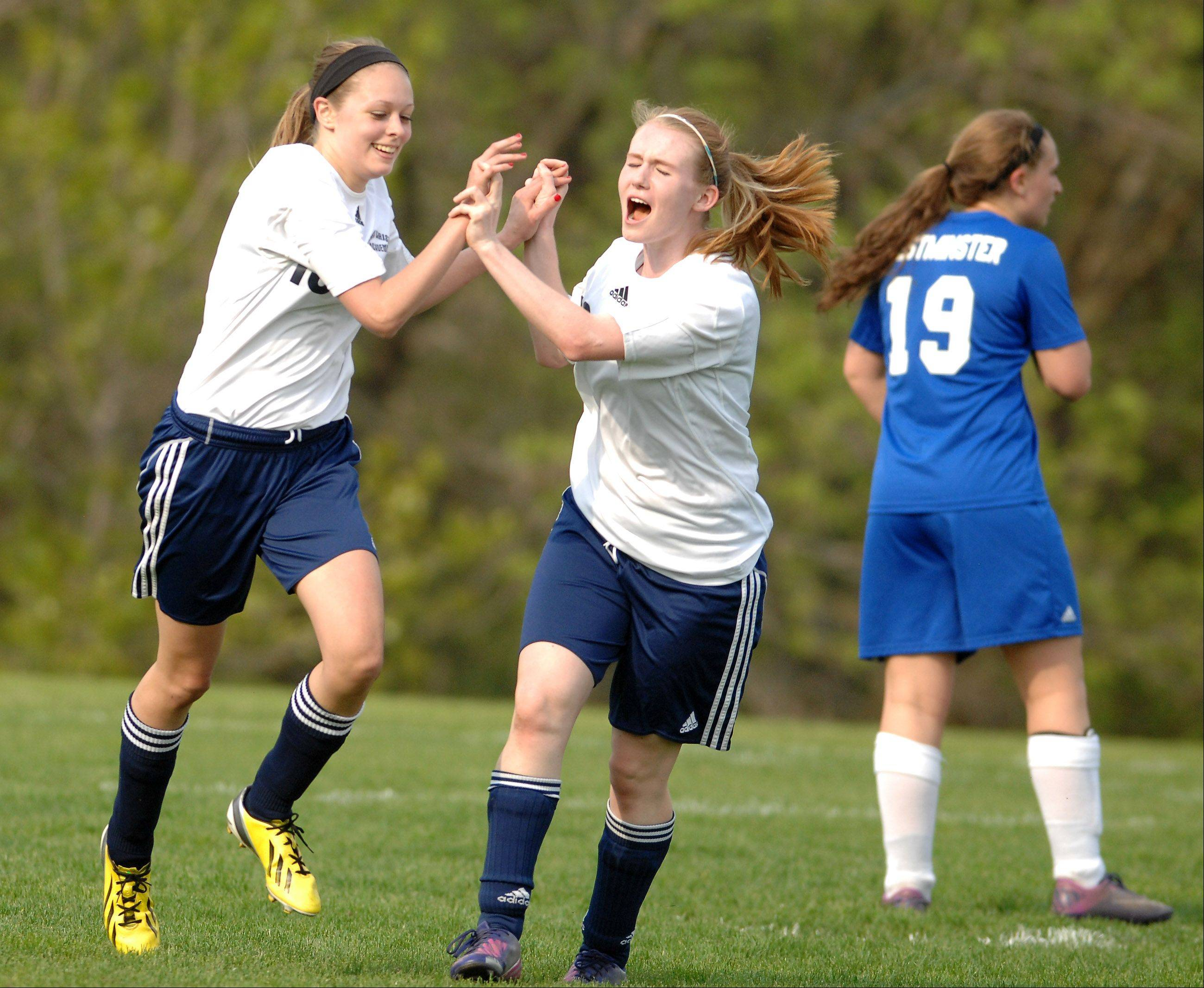 Harvest Christian's Ellie Burzlaff, left, and Morgan Lockwood celebrate a goal against Westminster Christian during Wednesday's Class 1A regional semifinal in Elgin.