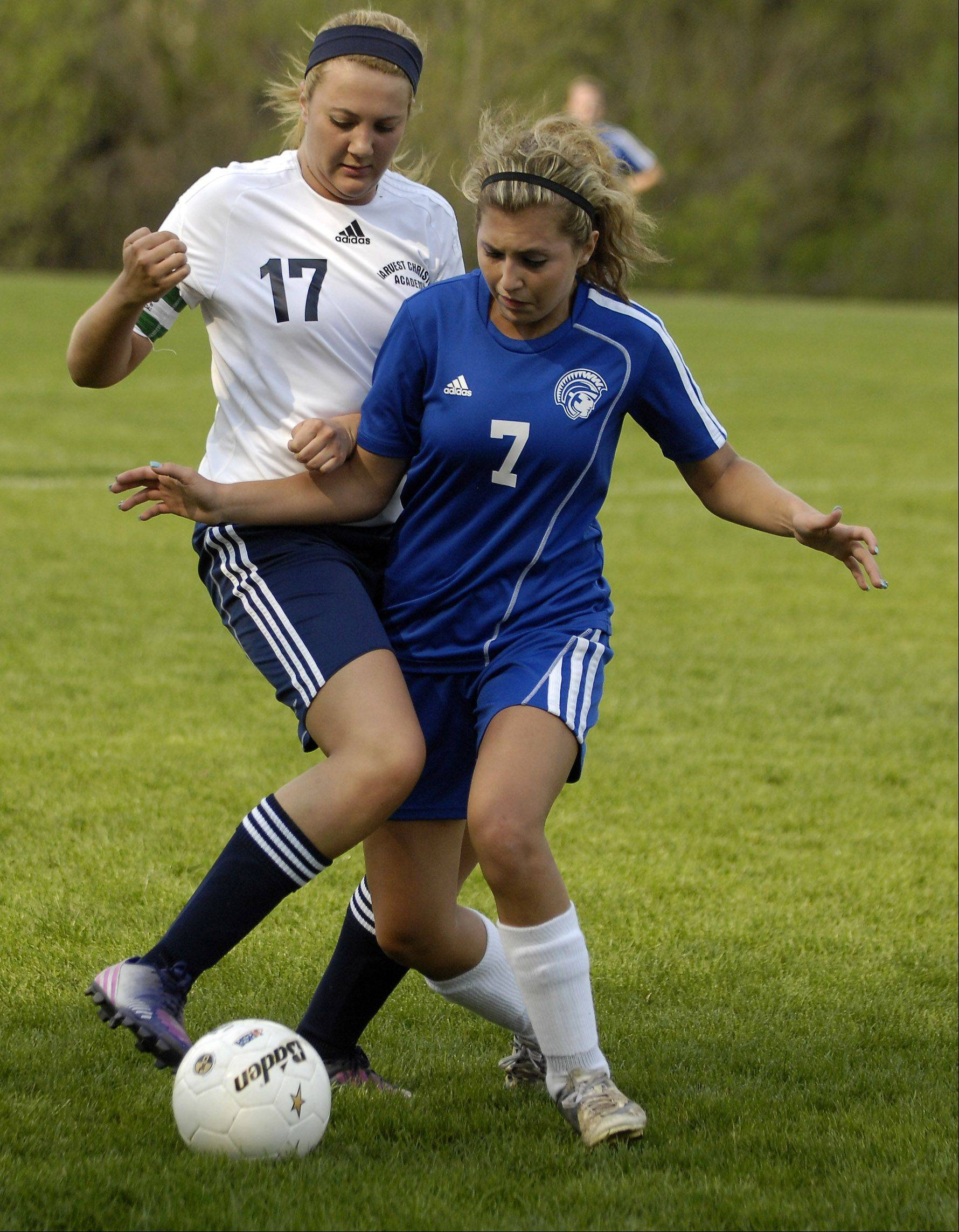 Harvest Christian's Erica Manusos, left, and Westminster Christian's Taylor Pedersen battle for the ball during Wednesday's Class 1A regional semifinal in Elgin.