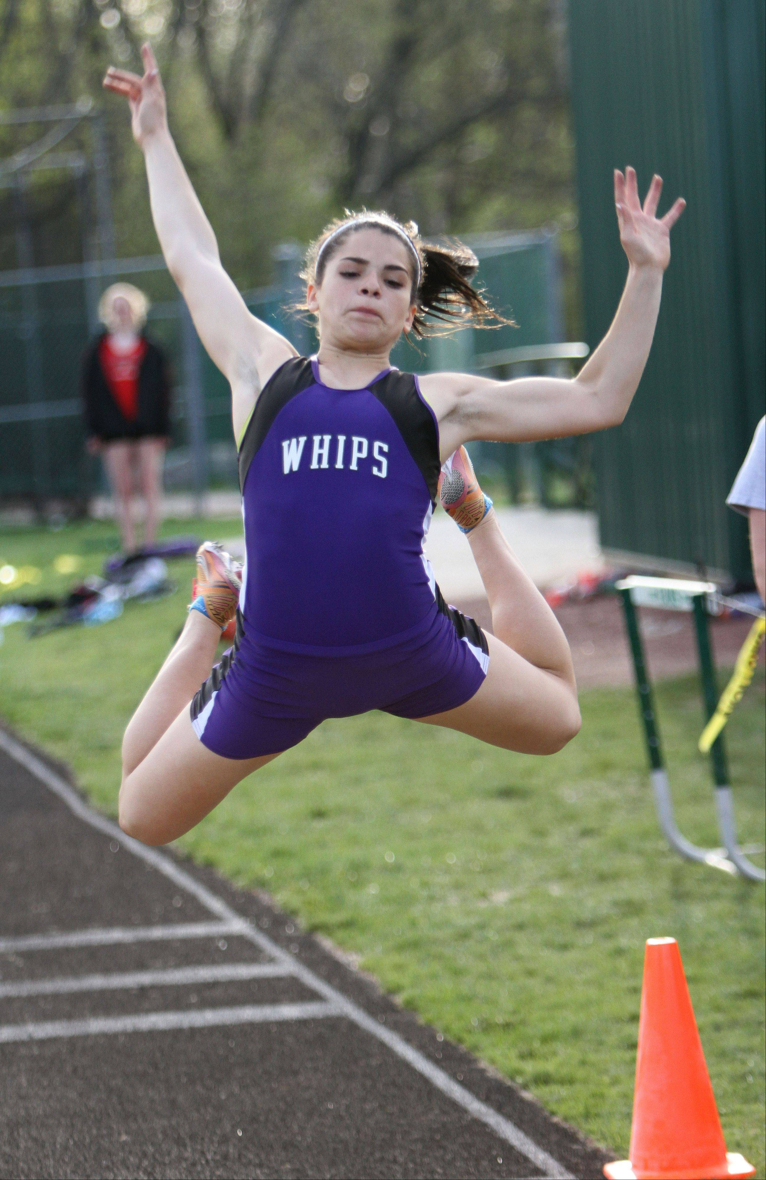 Hampshire's Elizabeth Pagan competes in the long jump during the Fox Valley Conference girls track meet Monday at Grayslake Central High School.
