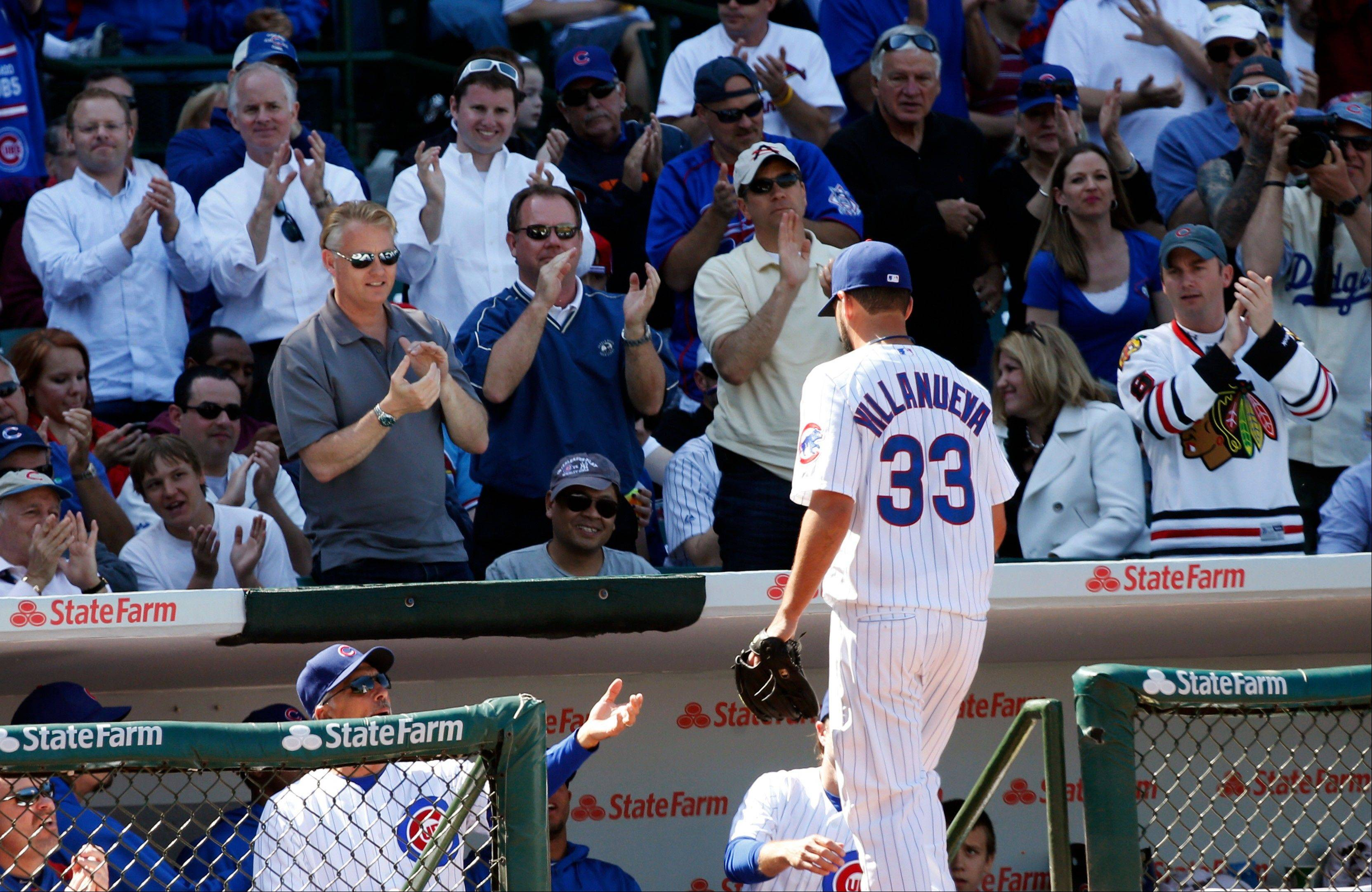 Cubs starting pitcher Carlos Villanueva leaves the field during the seventh inning of their 5-4 loss to the Cardinals on Wednesday at Wrigley Field.