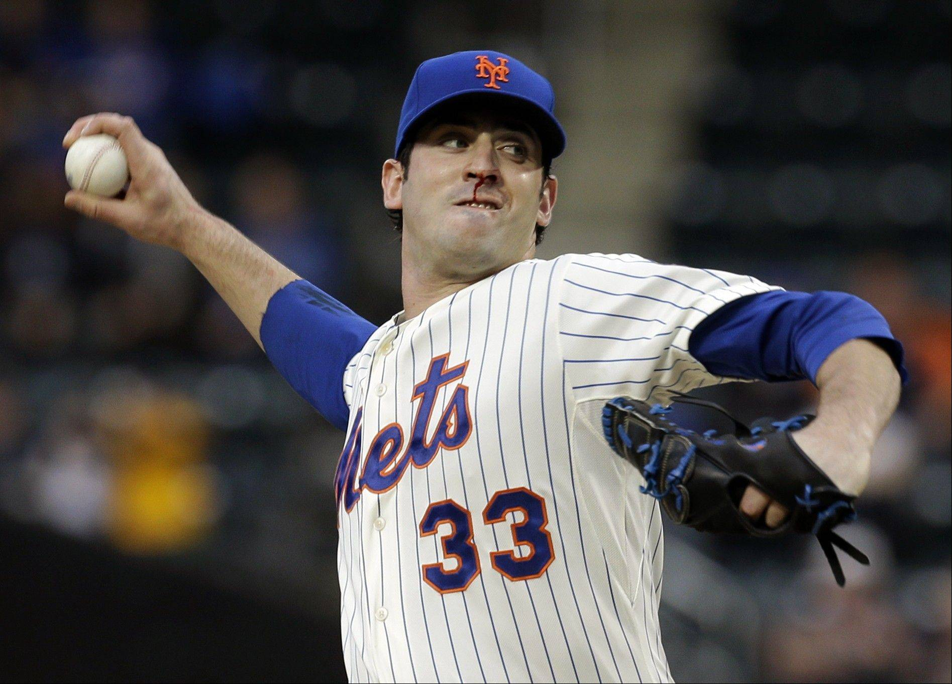 New York Mets starting pitcher Matt Harvey throws during the first inning of the baseball game against the Chicago White Sox at Citi Field on Tuesday, May 7, 2013 in New York.