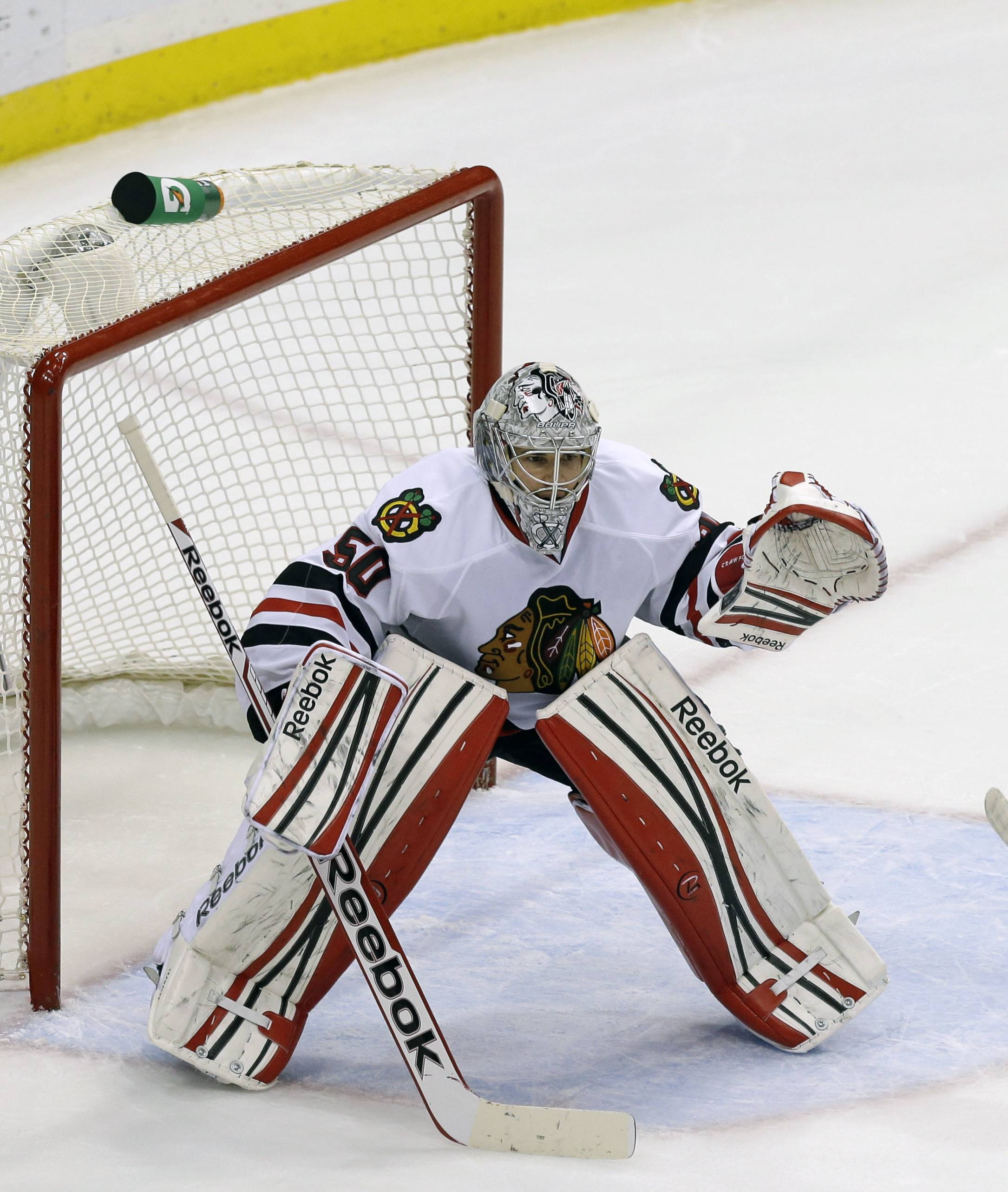 Chicago Blackhawks goalie Corey Crawford is shown in the second period of Game 4 of an NHL hockey Stanley Cup playoff series against the Minnesota Wild, Tuesday, May 7, 2013 in St. Paul, Minn. The Blackhawks won 3-0.