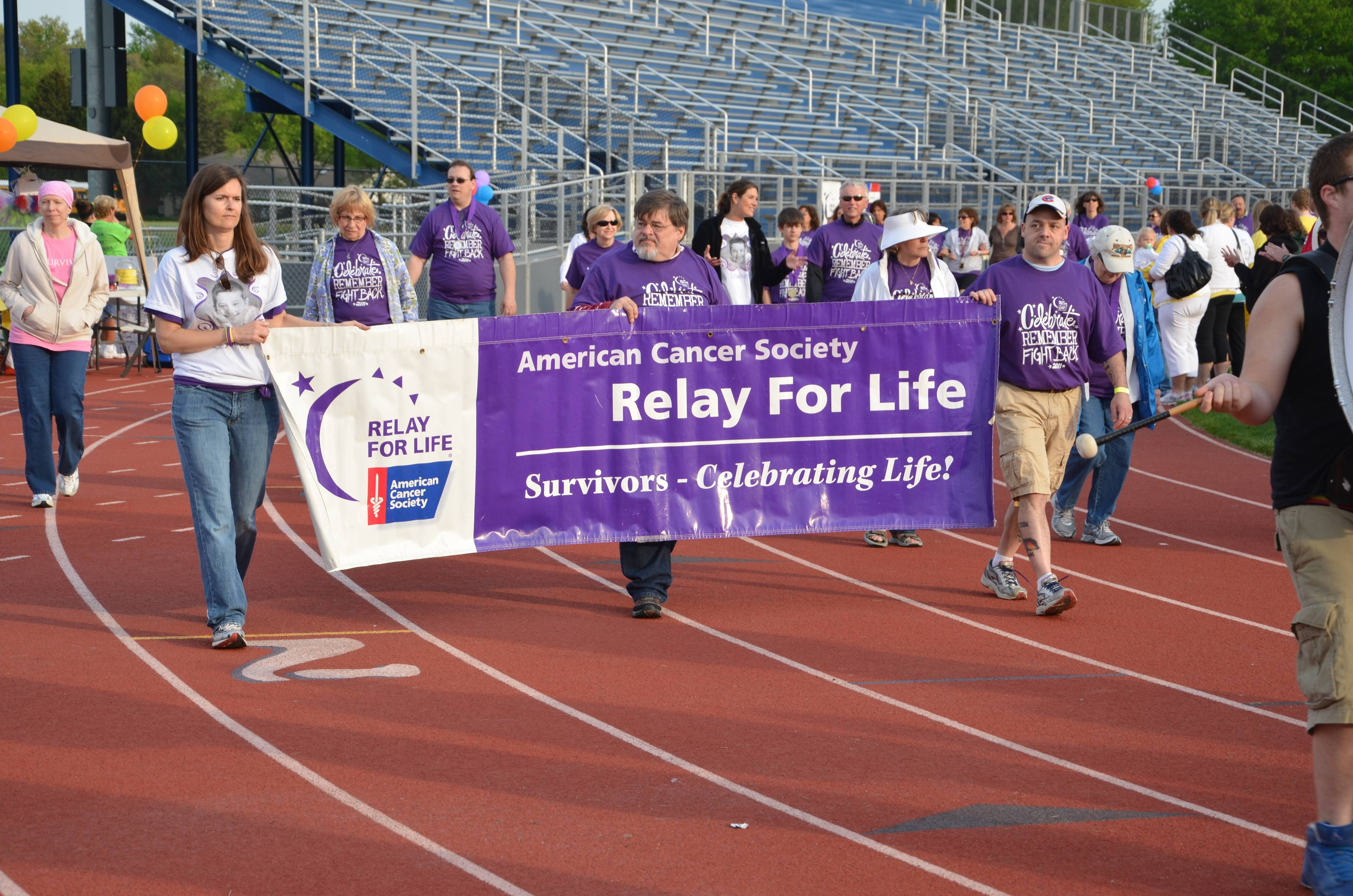 Cancer survivors walk the opening lap at the Relay for Life of Mt. Prospect/Prospect Heights.