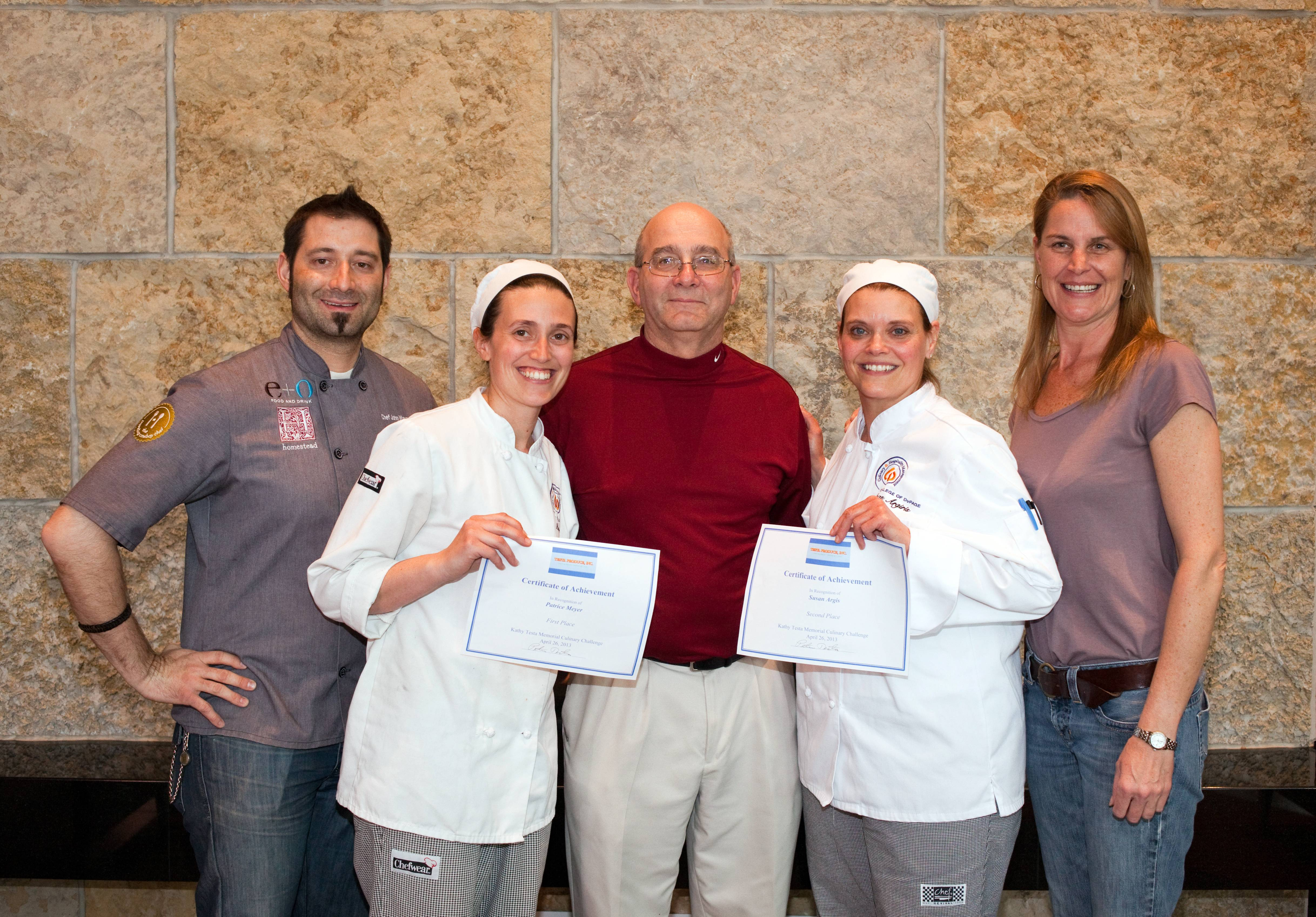 "Pete Testa (center), owner of Testa Produce, John ""Duke"" Wayne (far left), of E+O food and drink, and Courtney Barton (far right), Testa Produce executive chef, congratulate College of DuPage students and Testa Produce scholarship recipients Patrice Meyer of Naperville (center left) and Susan Argiris of Geneva (center right). Meyer and Argiris won first and second place, respectively"