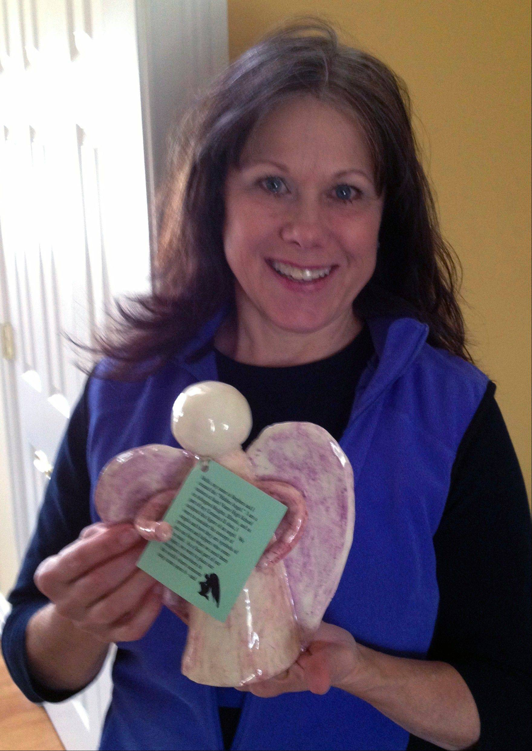 Deanna LeRose cherishes the hidden angel she found in a forest preserve in McHenry County.