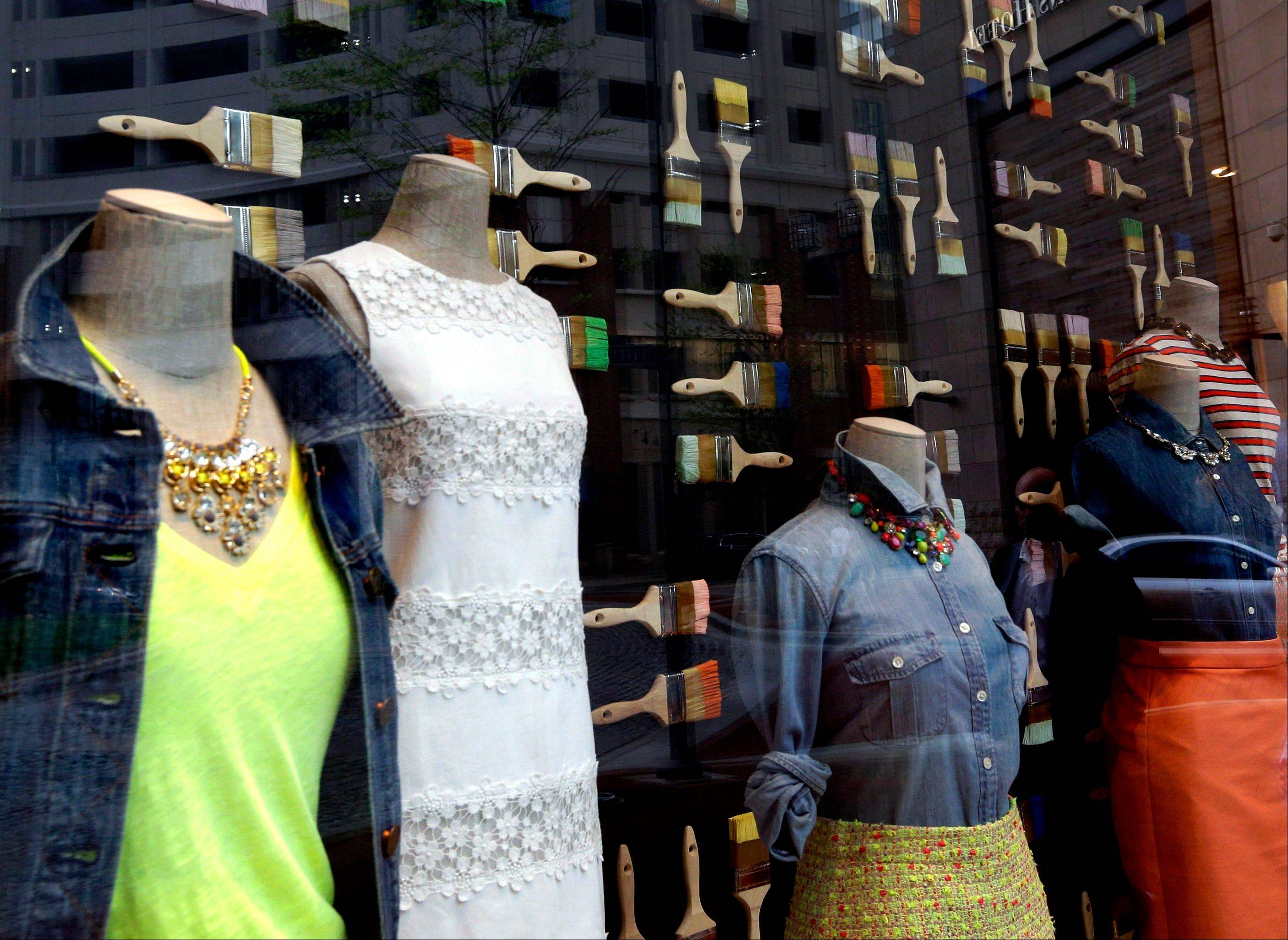 Clothing is modeled on mannequins in a retail store�s window display in Baltimore. A report released Thursday showed Americans spent more during the early spring months as part the latest sign that they�re encouraged by the economic recovery.