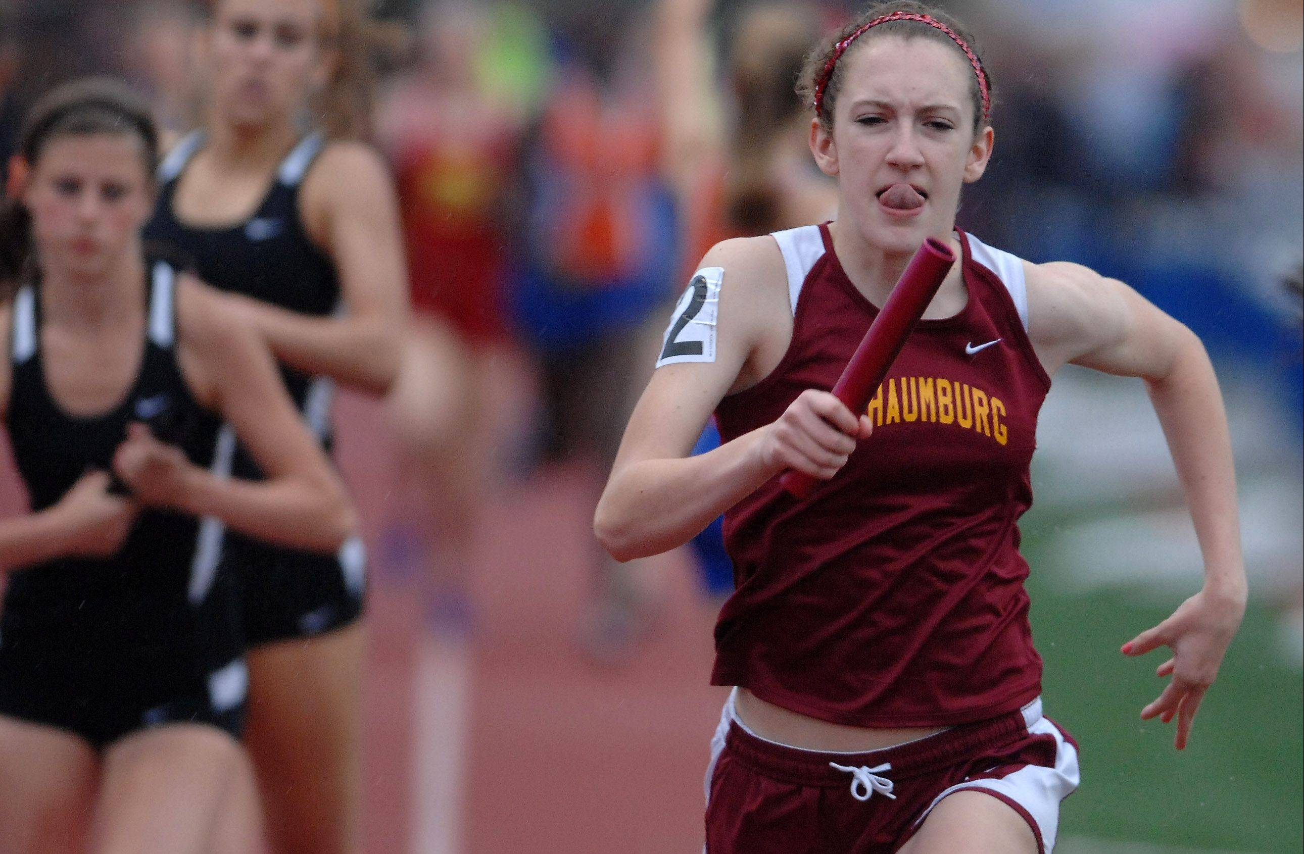Erin Falsey of Schaumburg runs the anchor leg of the Saxons� state-qualifying 3,200-meter relay during the West Aurora girls track sectional Thursday.