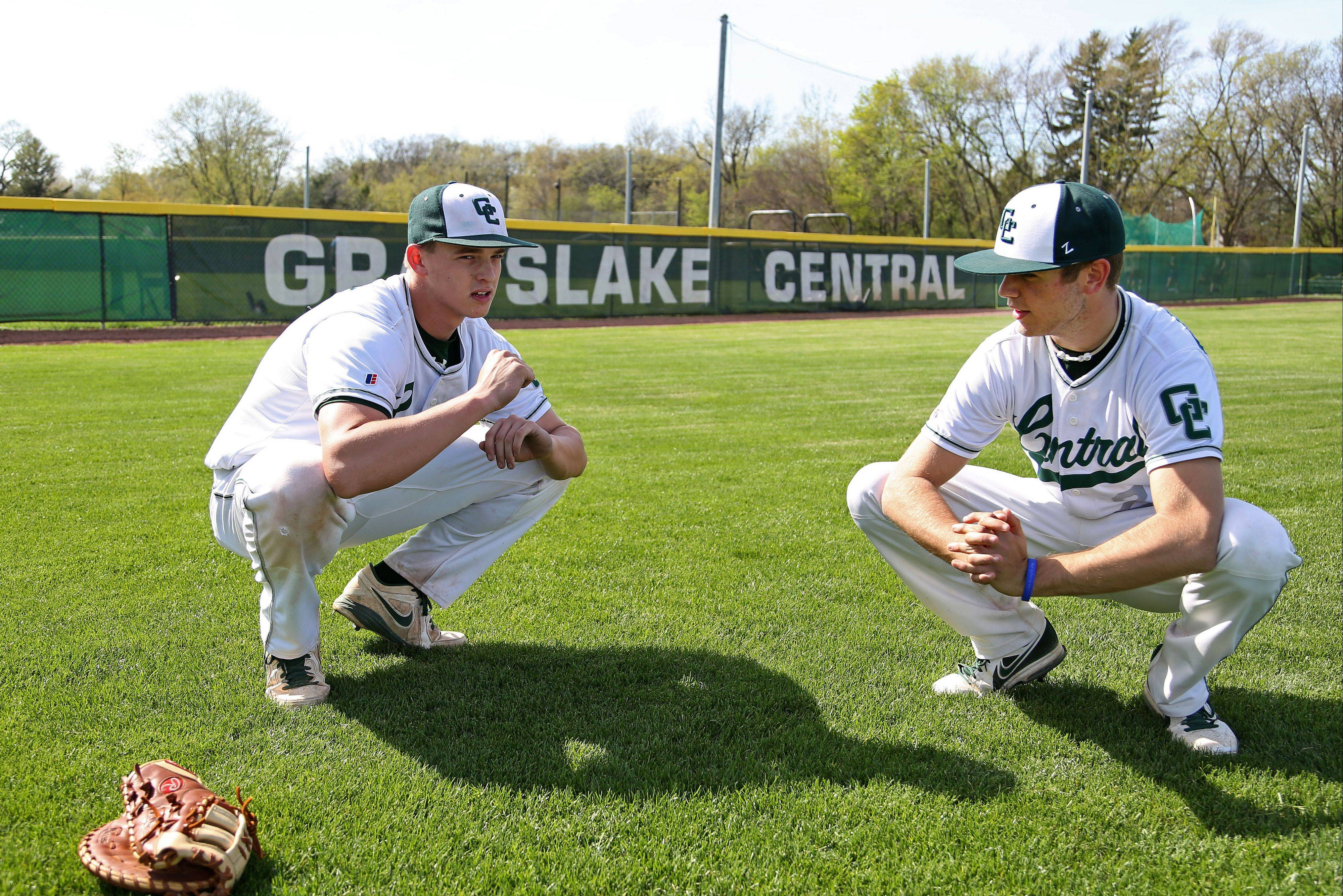 Grayslake Central baseball players Kyle Clark, left, and Christian Frusolone stretch before their game Tuesday. They took yoga in the off-season, and it�s helped their play this year.