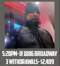 "A surveillance image taken from a graphic released by the U.S. Attorney's Office in New York City shows a man identified as ""defendant Reyes"" allegedly using fraudulent magnetic cards to steal money from one of several cash machines in Manhattan."