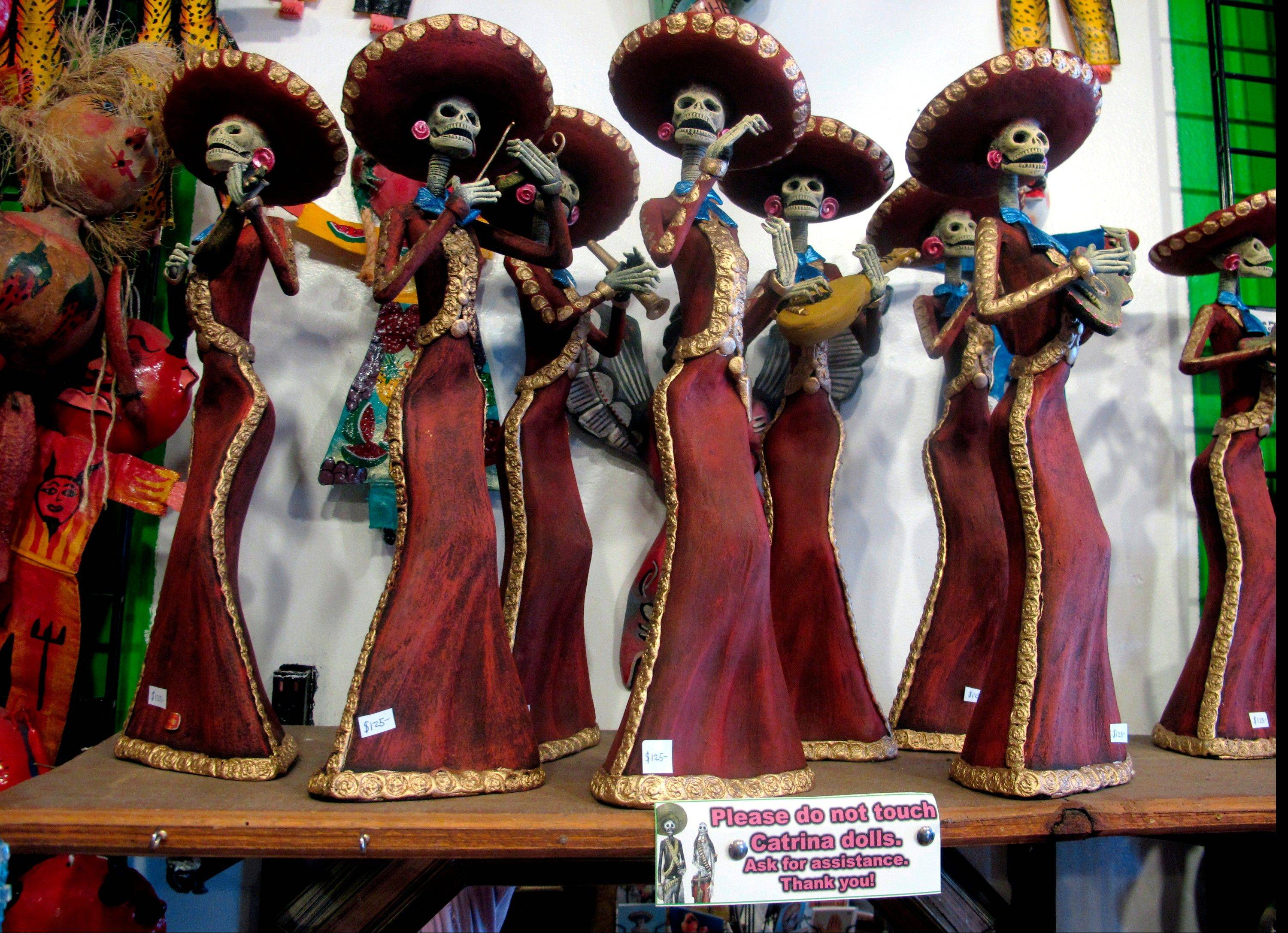 "Artwork at Masks y Mas, an Albuquerque shop that sells 'Day of the Dead' art year round. Disney announced Tuesday that it was a withdrawing a ""Dia de los Muertos"" trademark request it made to the U.S. Patent and Trademark Office amid uproar on social media from Latino activists, writer and artists."